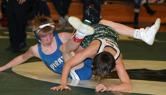 Pleasantville's Christian Perlleshi, right, defeated Pearl River's Ian Rowan in the 99-lb. match at the Division II wrestling dual meet championship Thursday at Pleasantville.