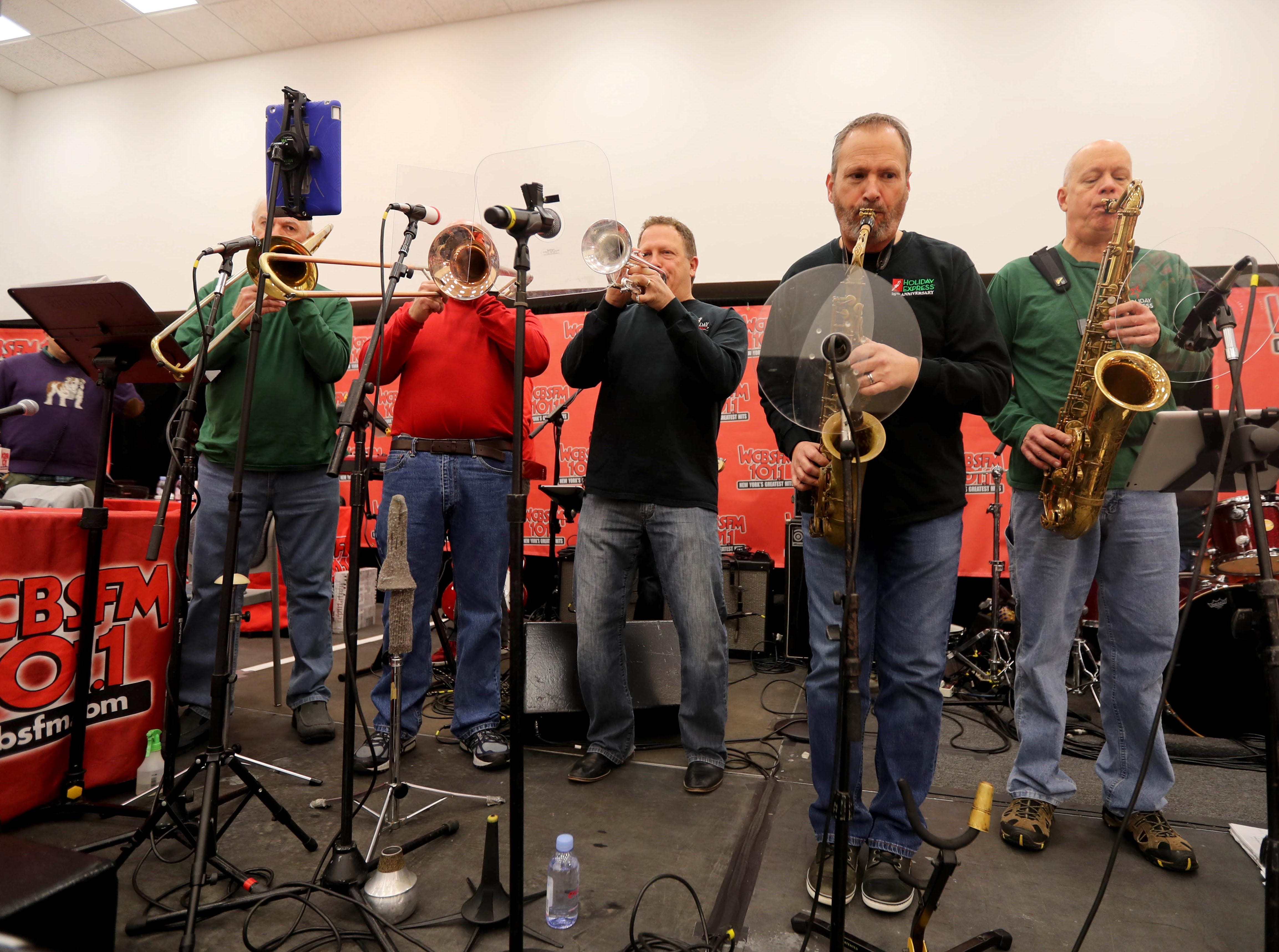 Musicians perform holiday songs during the annual holiday show at Blythedale Children's Hospital in Valhalla Dec. 14, 2018. Scott Shannon, morning disc jockey with WCBS-FM hosts the show every year. This year's show included performances by Rob Thomas of Matchbox Twenty, Mark Rivera, who is Billy Joel's longtime saxophonist, and Grammy nominated singer and songwriter Gavin DeGraw. The event included a live auction that featured autographed guitars by Jon Bon Jovi and Rob Thomas and tickets to a Billy Joel concert at Madison Square Garden.