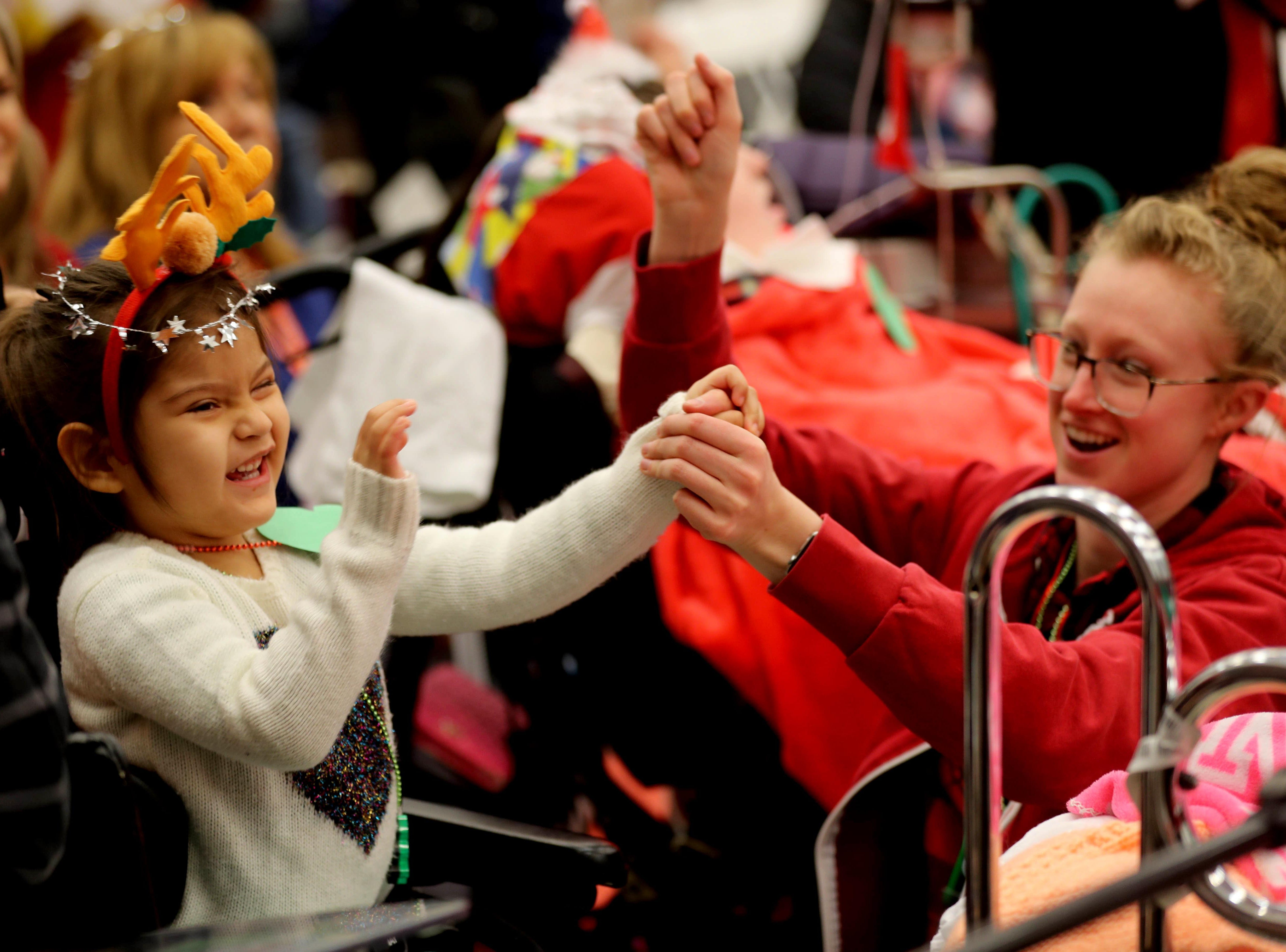 Daniela Hernandez, 5, a patient at Blythedale Children's Hospital in Valhalla, enjoys holiday music with recreation therapist Laura Wallace during the annual holiday show at the hospital Dec. 14, 2018. Scott Shannon, morning disc jockey with WCBS-FM hosts the show every year. This year's show included performances by Rob Thomas of Matchbox Twenty, Mark Rivera, who is Billy Joel's longtime saxophonist, and Grammy nominated singer and songwriter Gavin DeGraw. The event included a live auction that featured autographed guitars by Jon Bon Jovi and Rob Thomas and tickets to a Billy Joel concert at Madison Square Garden.