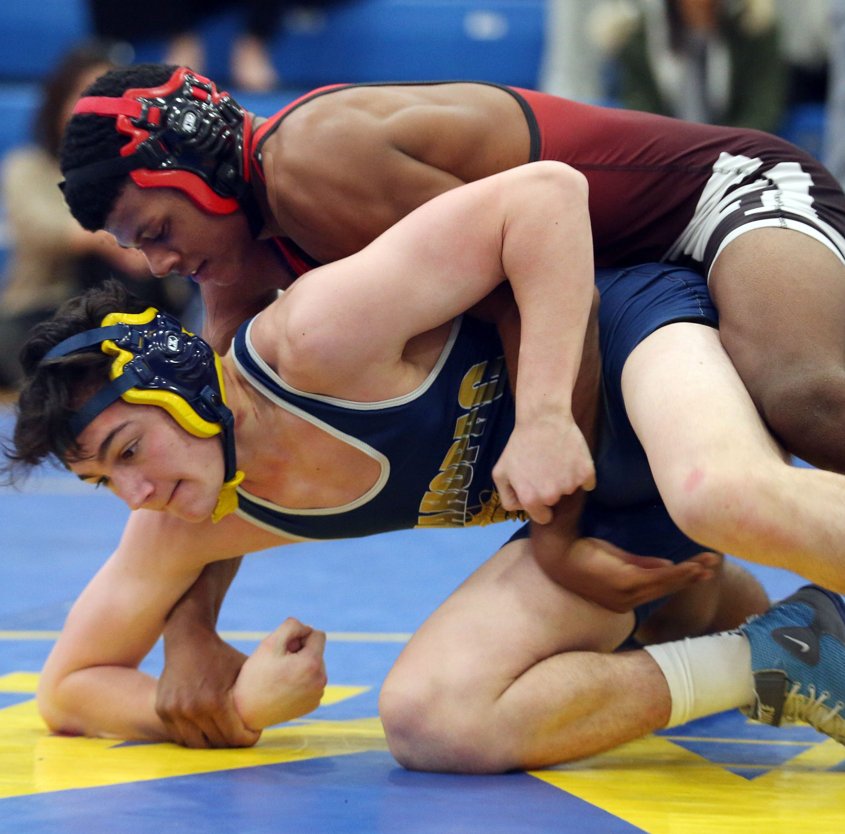 Wrestling: Quincy Downes' dramatic pin pushes Fox Lane to repeat as dual meet champs
