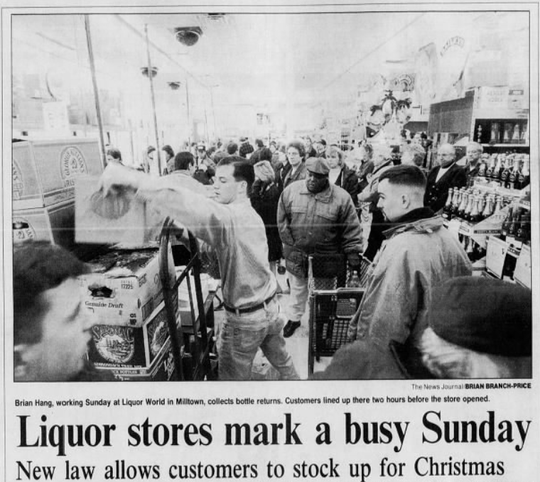 A clipping from December edition of The News Journal showing locals taking advantage of a new law that allowed them to buy liquor on Sundays when the following Monday was Christmas.