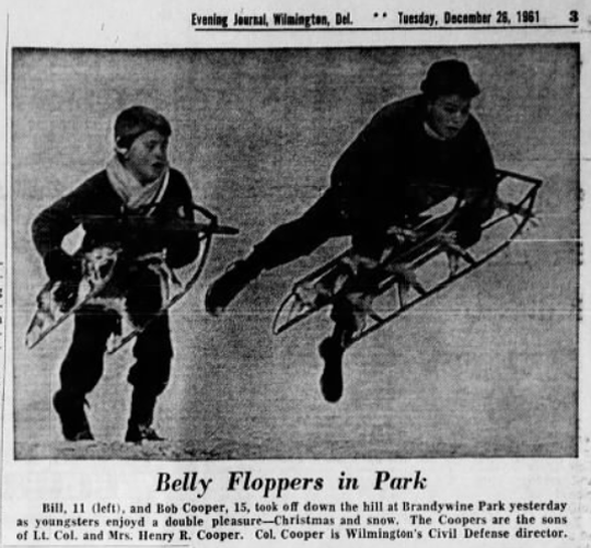 A clipping from a 1961 Evening Journal showing two brothers playing on a snowy Christmas Day.