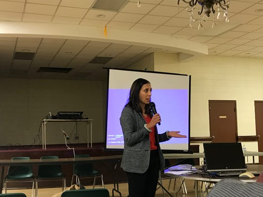 Lisa Dharwadkar, vice president of Pennsylvania company Walan Specialty Construction Products, speaks to Southbridge residents in December 2018.