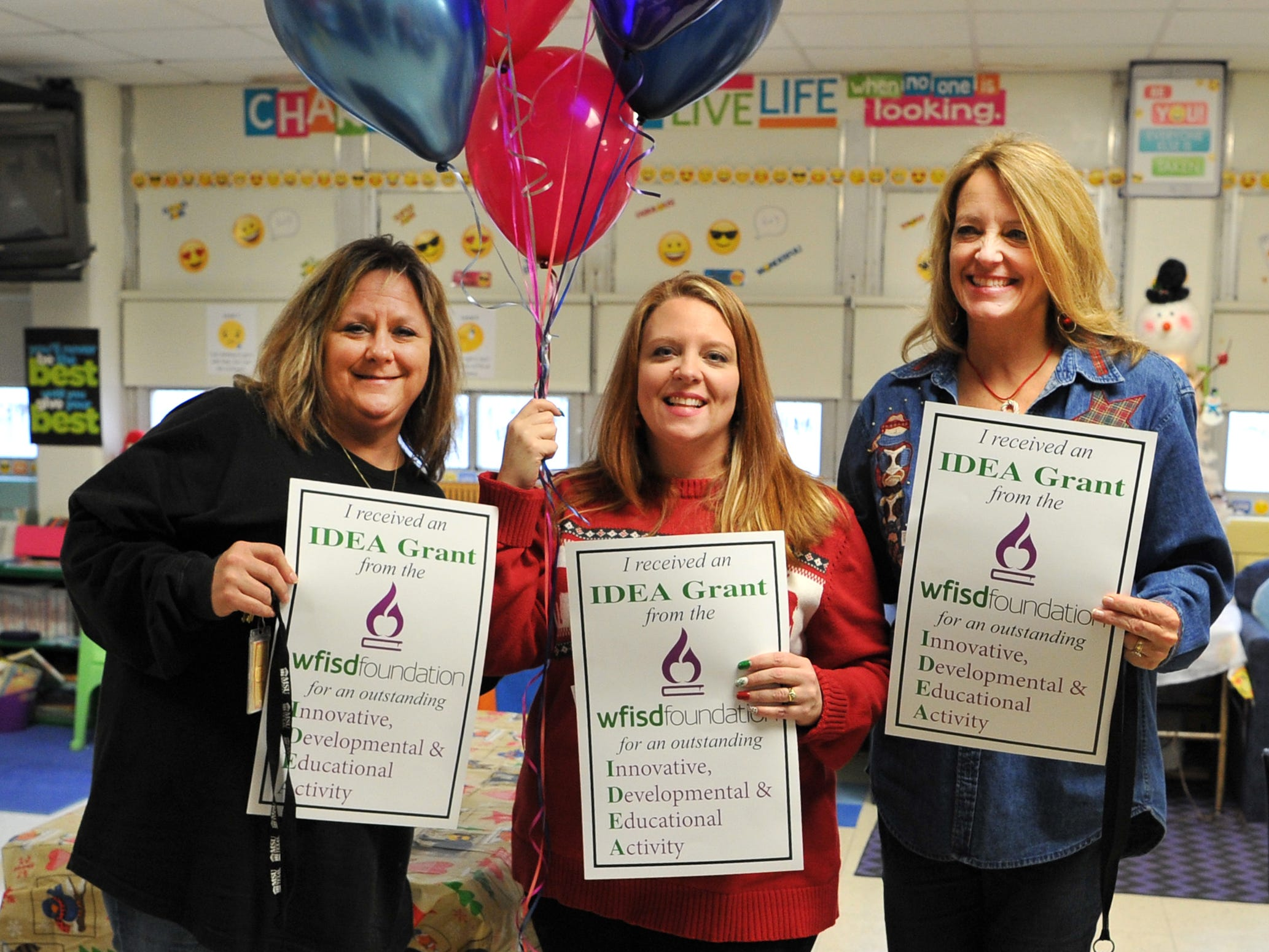 WFISD K-2 Specialist, Kristen Sarafis prepares to surprise some teachers at Booker T. Washington Elementary with IDEA Grants Friday morning.
