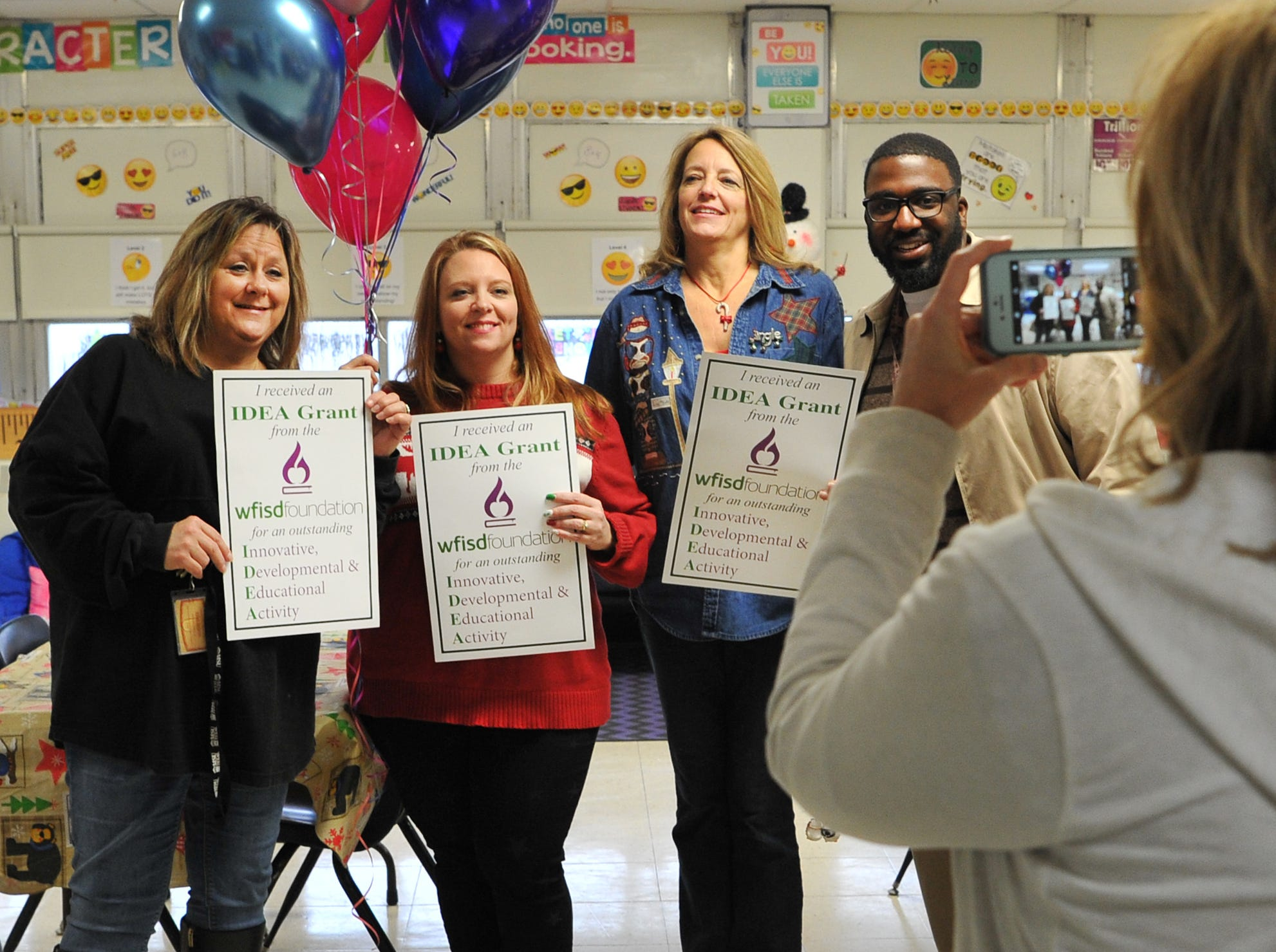 Booker T. Washington Elementary 5th grade teachers, from left: Angela Nunn, Kellie Hare, Janet Hughes, and principal Mark Davis pose for a photograph, Friday morning after receiving an IDEA Grant.