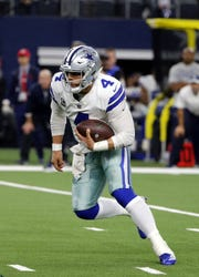 Dallas Cowboys' Dak Prescott (4) runs the ball during overtime of an NFL football game against the Philadelphia Eagles in Arlington, Texas, Sunday, Dec. 9, 2018.