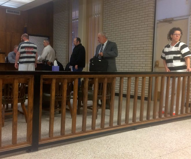 Bill Monroe Day stands before the bench Thursday in 50th District Court in Seymour. His wife, Laura Day, stands at the rail. Both agreed to plea bargains regarding charges against them involving child pornography and the sexual assault of a 1-year-old. Others, from left, are District Clerk Chris Jakubicek, Sheriff Jason Zeissel, Deputy Bryan Vest and Reginald Wilson, Bill Day's court-appointed attorney.