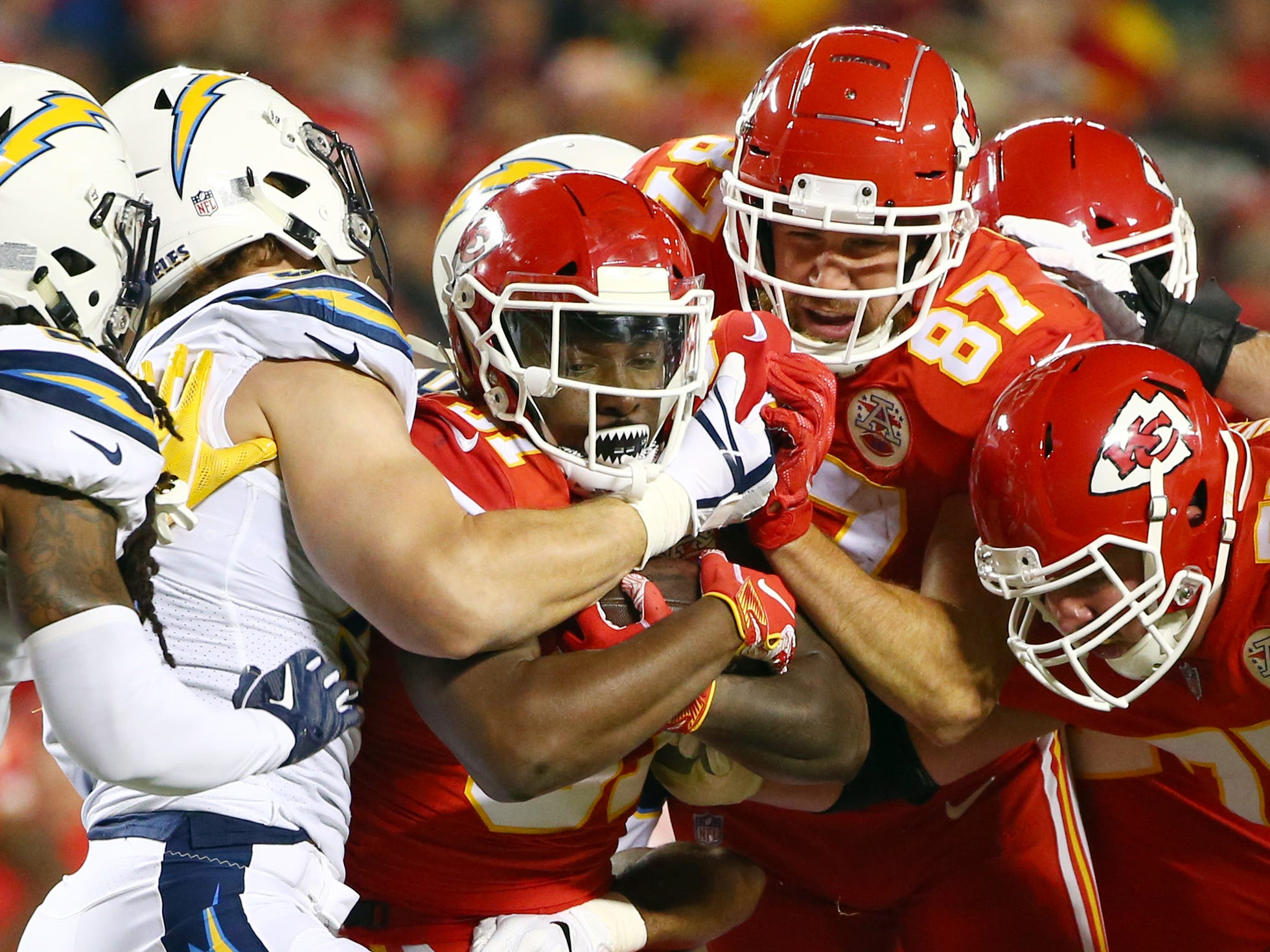 Kansas City Chiefs running back Darrel Williams is tackled by the Los Angeles Chargers' Joey Bosa in the first half at Arrowhead Stadium.