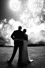 Prince Harry and Duchess Meghan of Sussex watch fireworks at their wedding reception at Frogmore House, Windsor, on May 19, 2018. The picture is on their Christmas card for 2018.