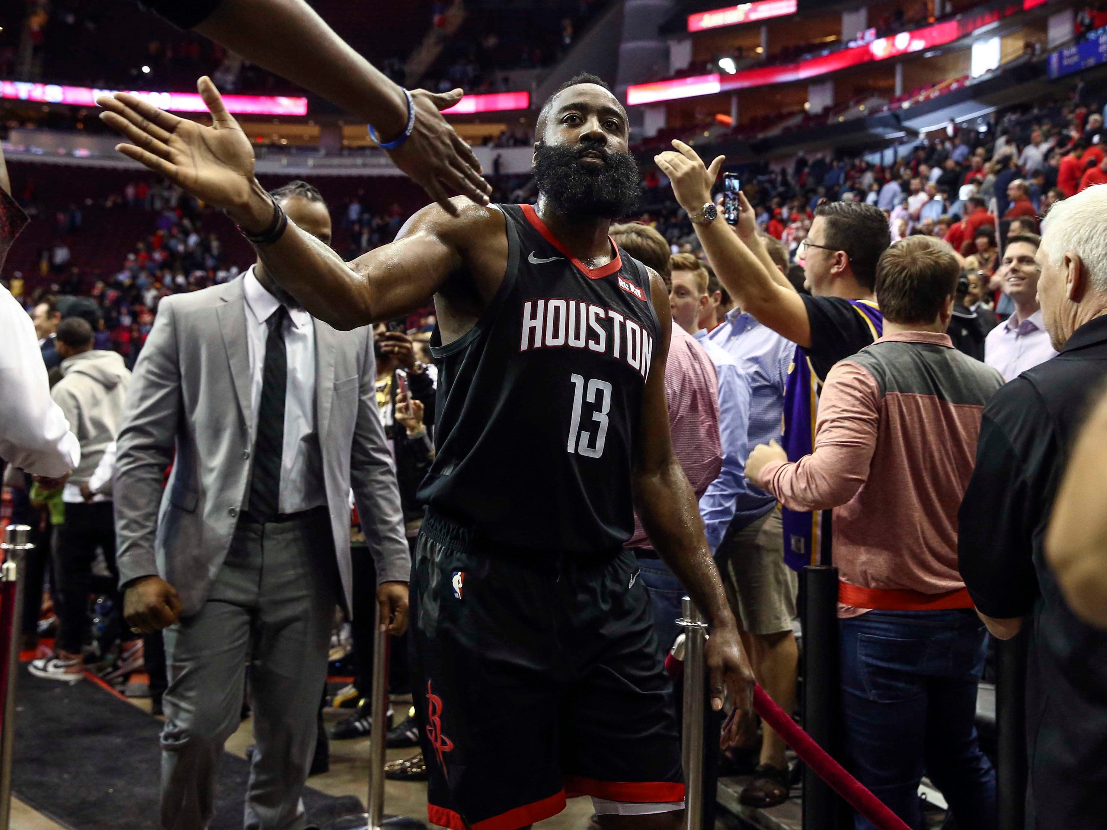 Dec. 13: Rockets star James Harden feels the love from the home crowd after scorching the Lakers for 50 points and a triple-double in a much-needed win.