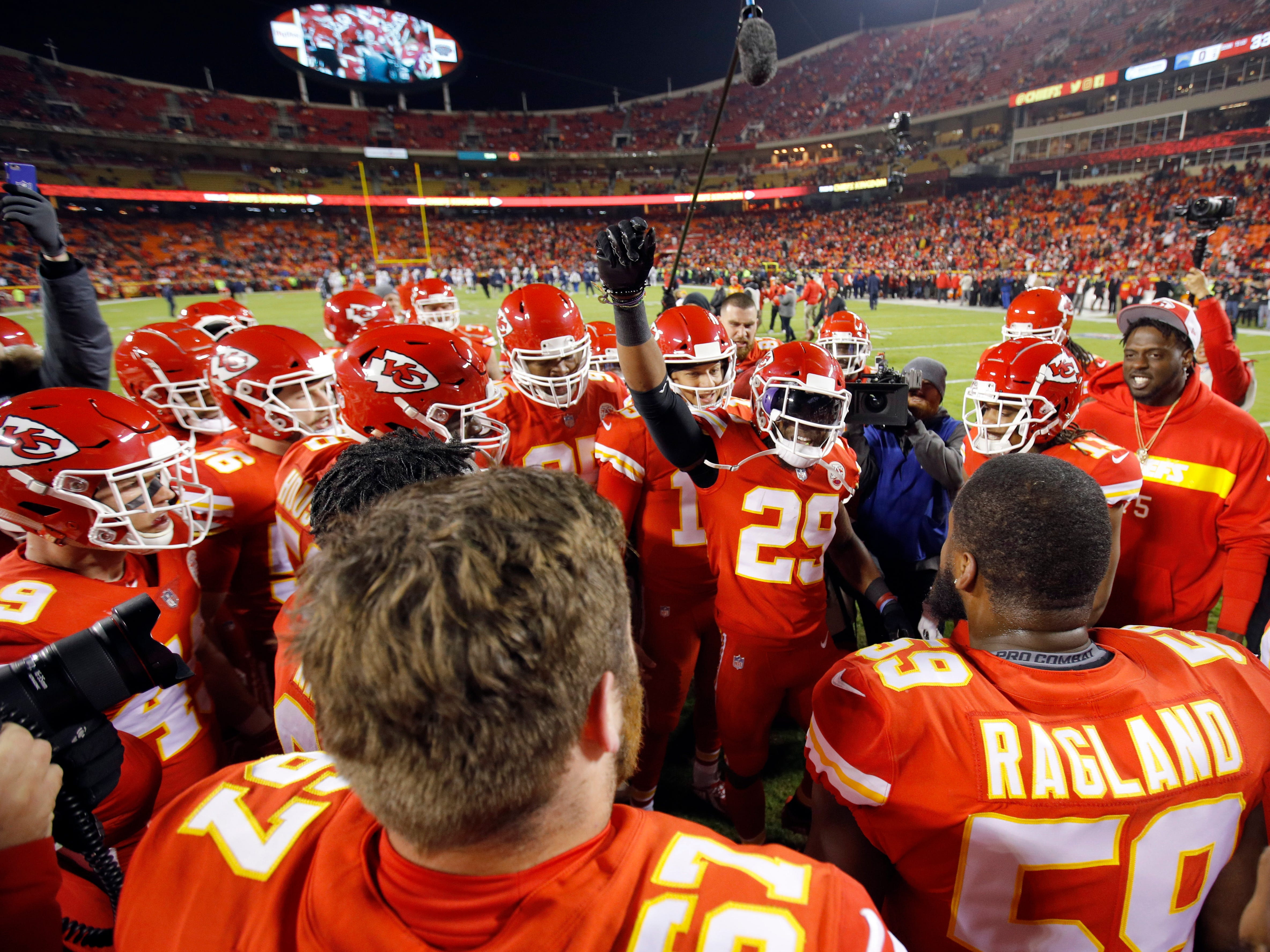 Kansas City Chiefs players gather around defensive back Eric Berry (29) and quarterback Patrick Mahomes (15) before the game against the Los Angeles Chargers.