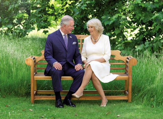 Prince Charles and Duchess Camilla pose on the grounds of Clarence House, London, for their 2018 Christmas card.