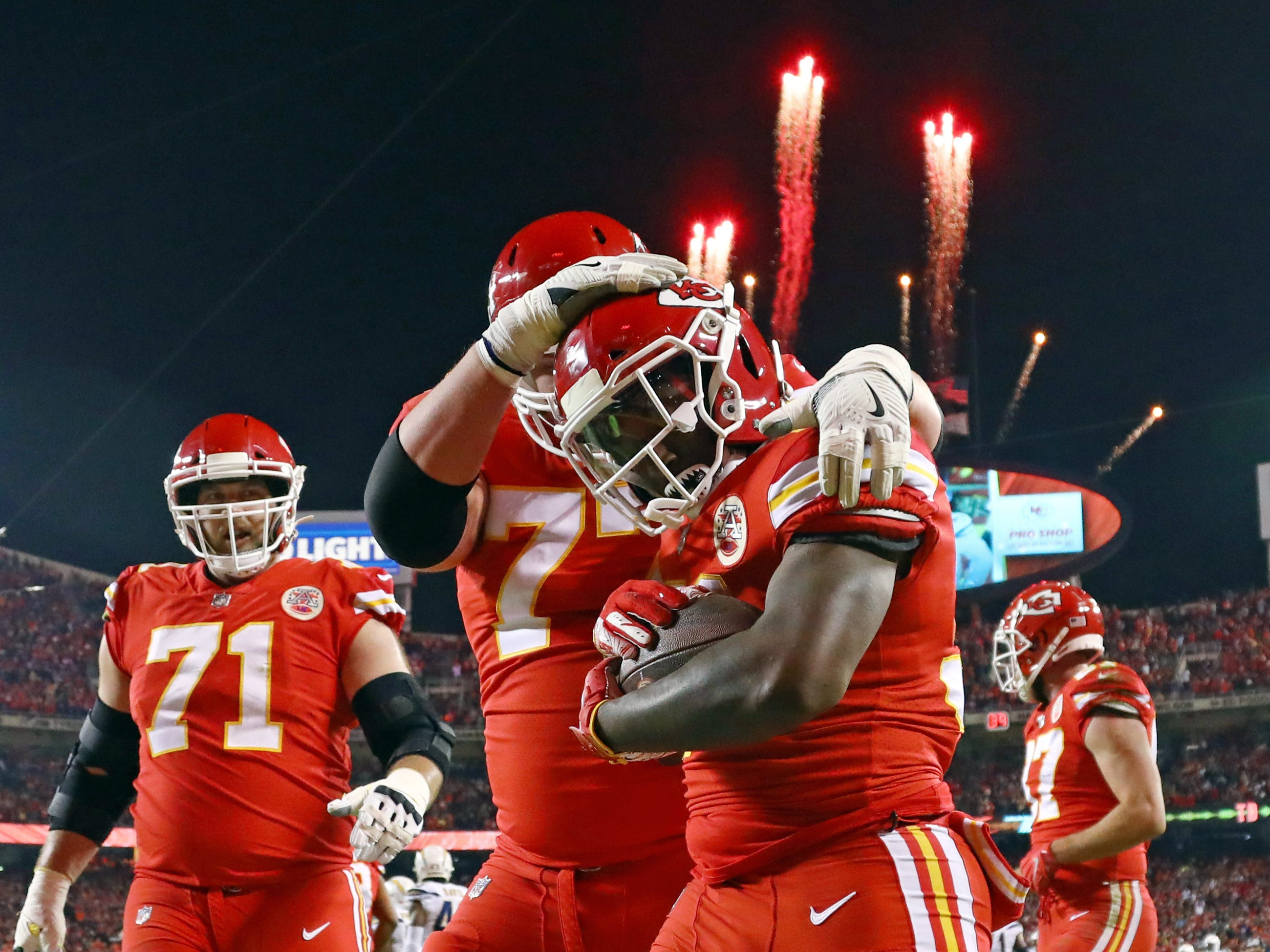 Kansas City Chiefs running back Darrel Williams is congratulated by offensive tackle Andrew Wylie (77) after scoring a touchdown against the Los Angeles Chargers in the first half at Arrowhead Stadium.
