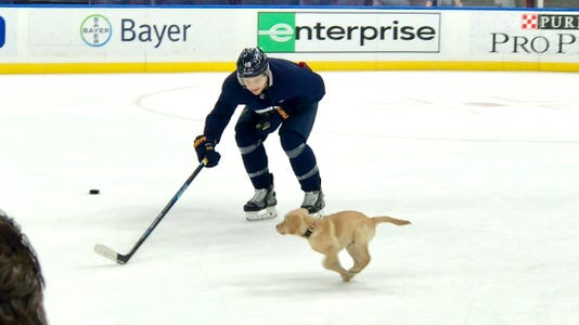 Barclay runs across the ice after a Blues practice.