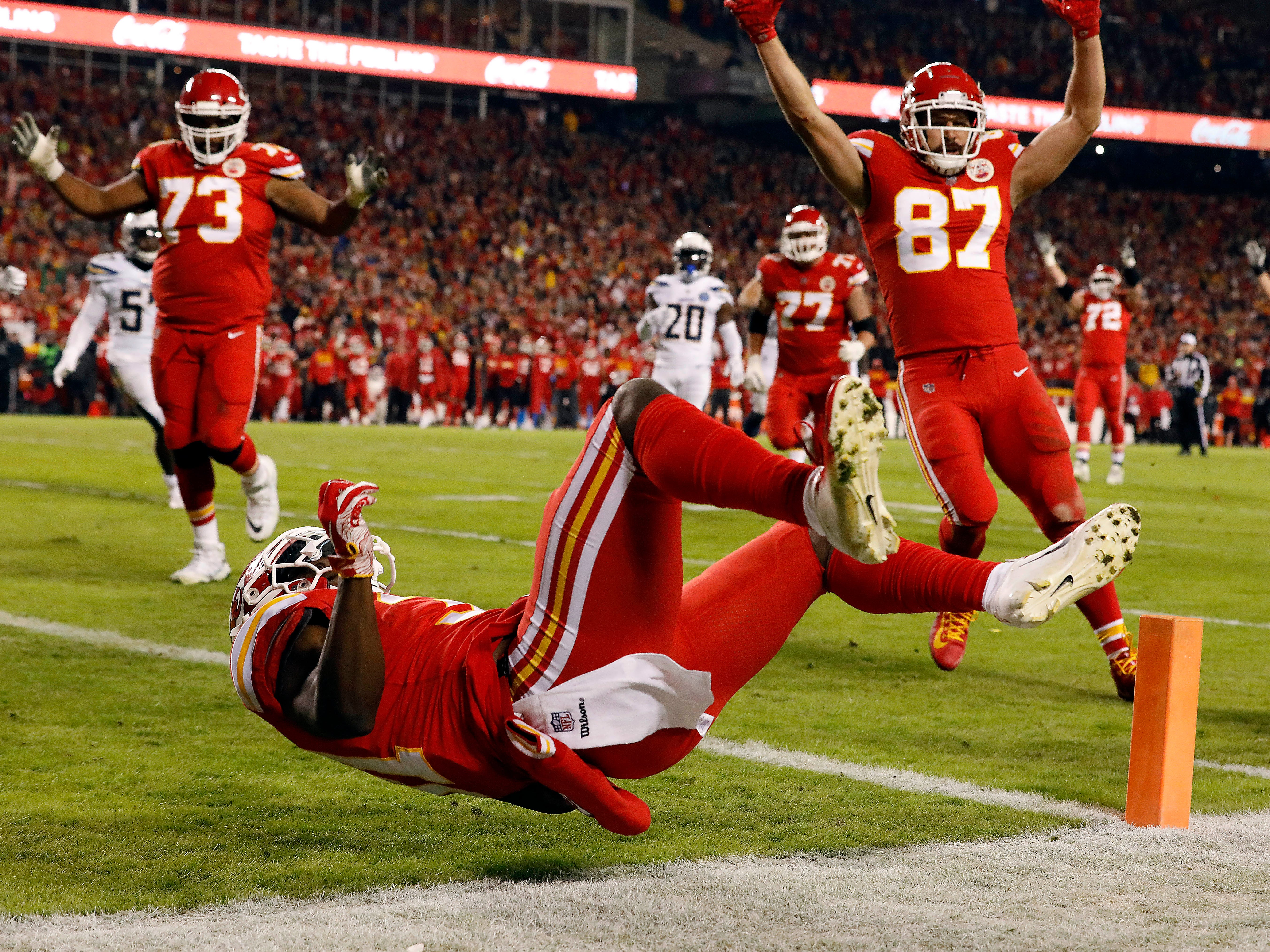Darrel Williams dives into the end zone for a touchdown against the Los Angeles Chargers at Arrowhead Stadium.