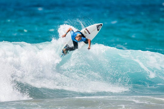 In this handout photo from the World Surf League (WSL), Summer Macedo of Hawaii is shown on a winning ride during the Jeep surfing World Junior Championship at Kiama, Australia, in early 2018. In September 2018, the WSL announced it would be paying women the same prize money as men in a first for the sport.
