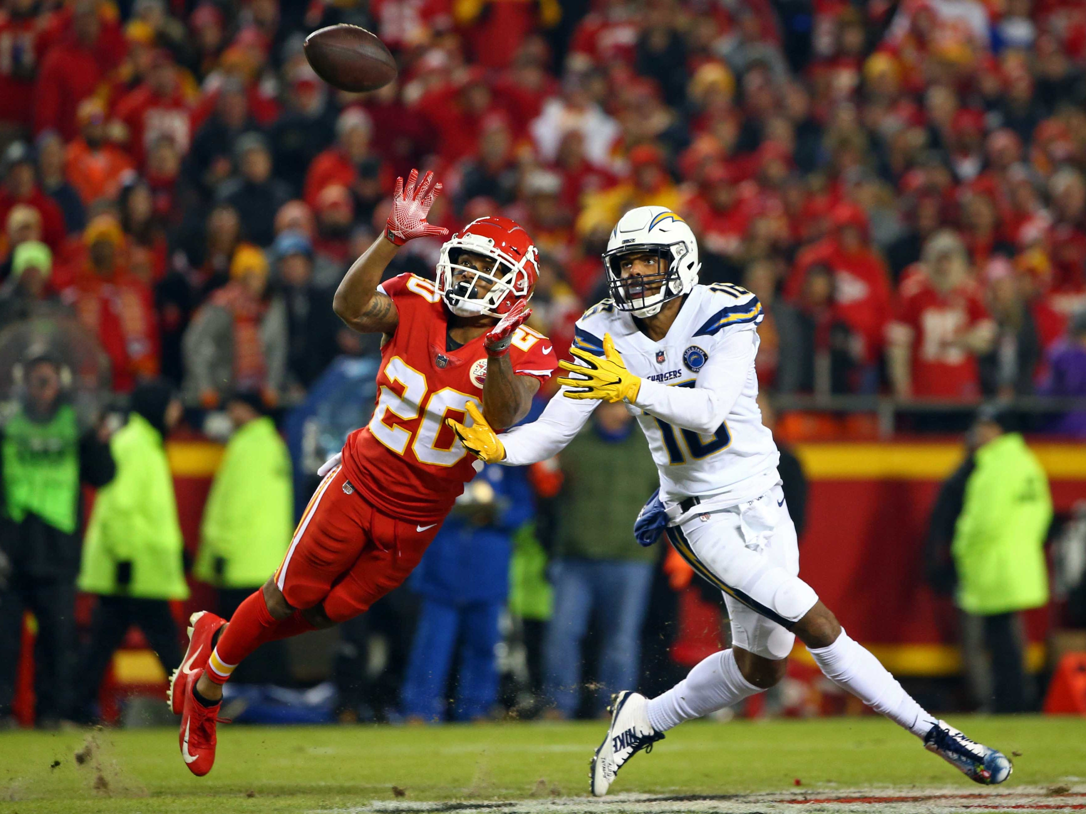 Kansas City Chiefs cornerback Steven Nelson (20) intercepts a pass intended for Los Angeles Chargers wide receiver Tyrell Williams (16) in the first half at Arrowhead Stadium.