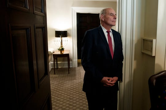 White House Chief of Staff John Kelly listens as President Donald Trump speaks during a meeting with newly elected governors in the Cabinet Room of the White House Dec. 13, 2018, in Washington.