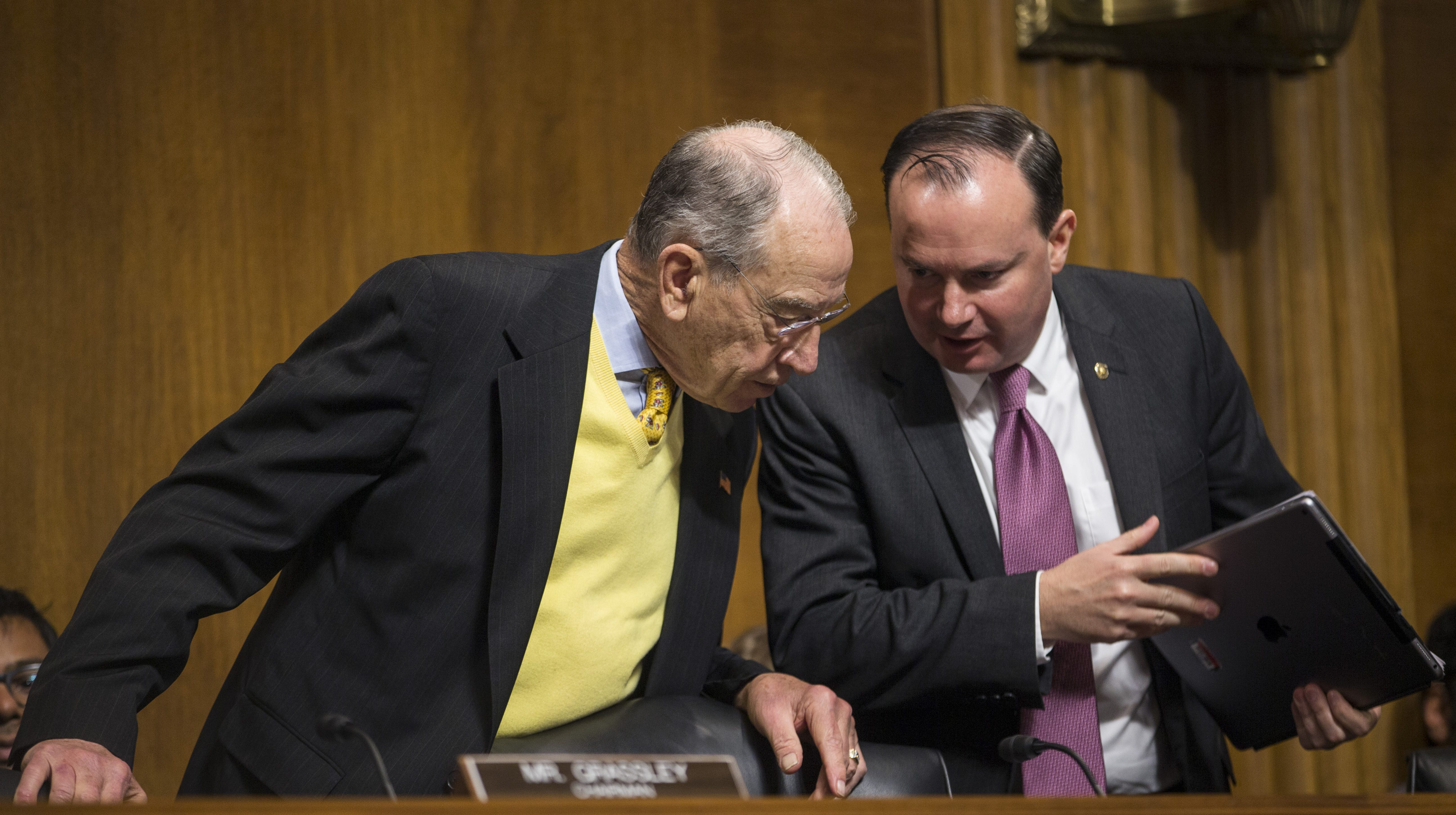 Sen. Mike Lee, R-Utah, speaks to Senate Judiciary Committee Chairman Sen. Chuck Grassley, R-Iowa, during a Senate Judiciary Committee hearing on December 11, 2018 in Washington, D.C. Lee and Grassley have been working to get a criminal justice reform bill over the finish line.