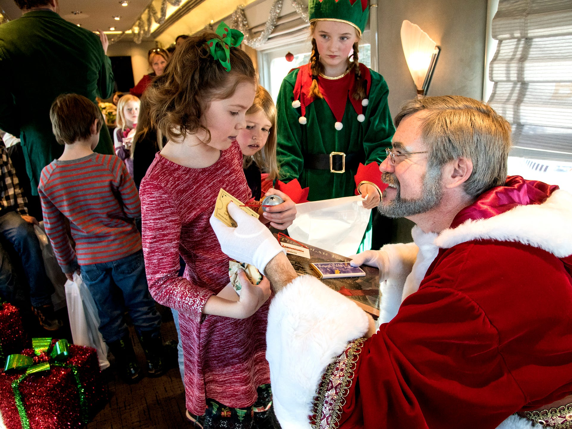 """Santa gives out presents to Livingston, Mont. students on the Christmas Express on Dec. 7, 2018. Montana Rail Link partnered with Livingston School District to reward 30 kindergarten, first and second-graders with a two-hour train ride modeled off of the popular book and movie, """"Polar Express."""""""