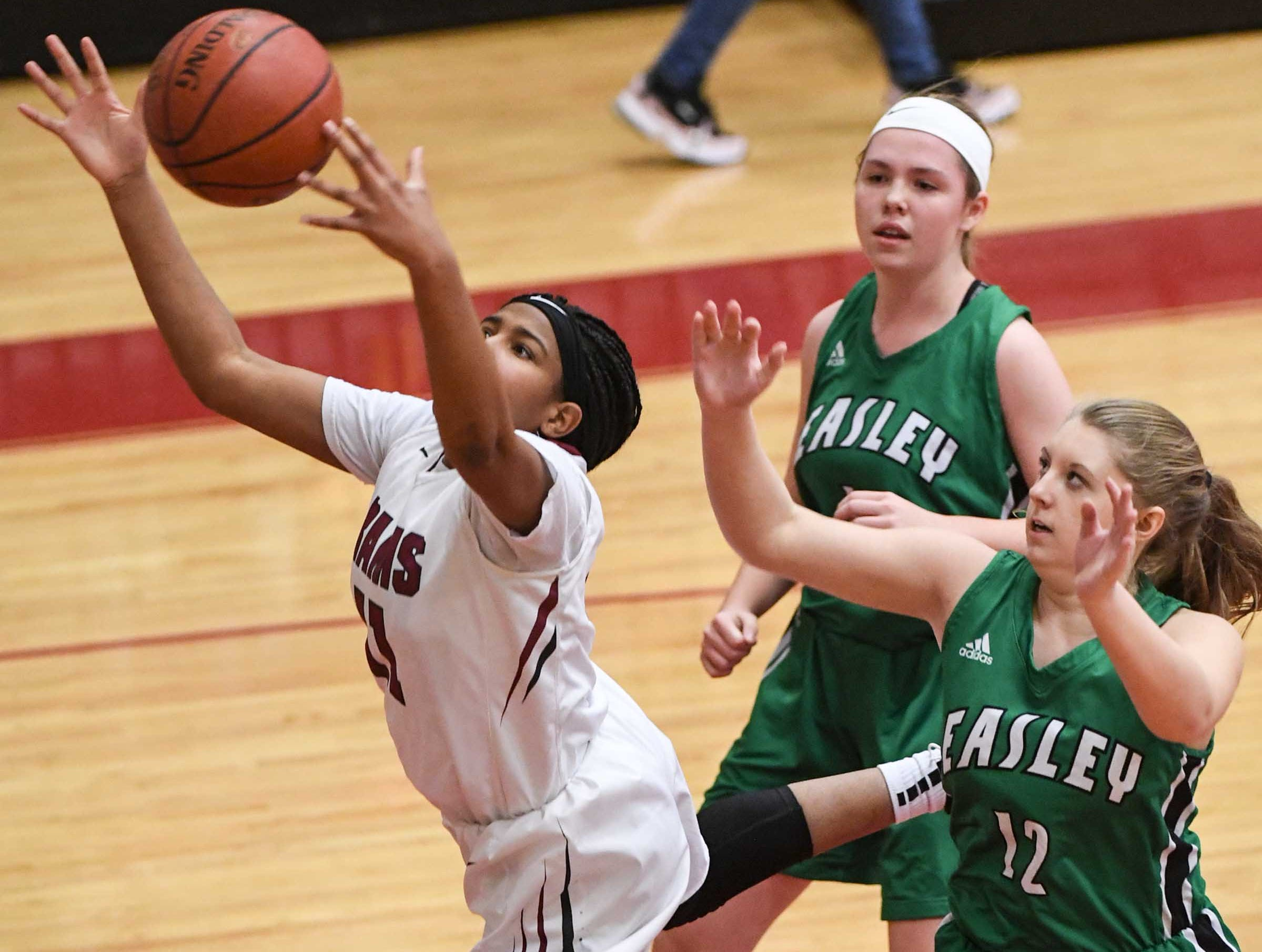 Westside freshman Destiny Middleton(11) reaches for a ball near Easley sophomore Rachel Fuller(12) during the third quarter at Westside High School in Anderson on Friday.