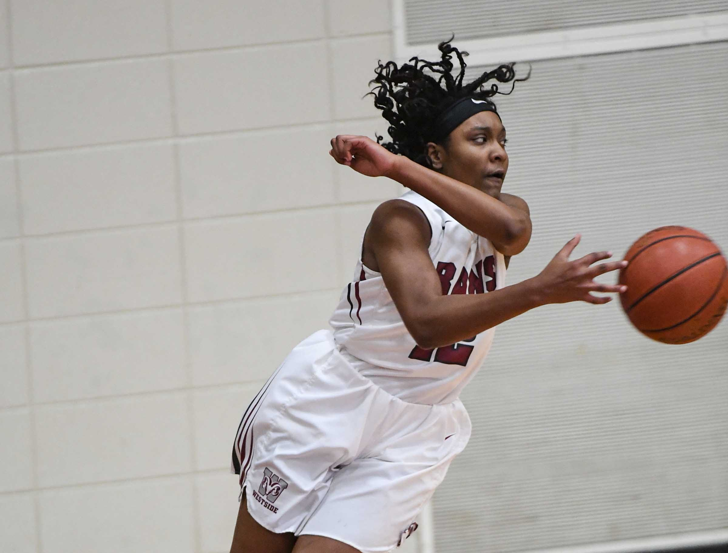 Westside freshman Branya Pruitt(12) saves a ball from going out of bounds against Easley during the second quarter at Westside High School in Anderson on Friday.