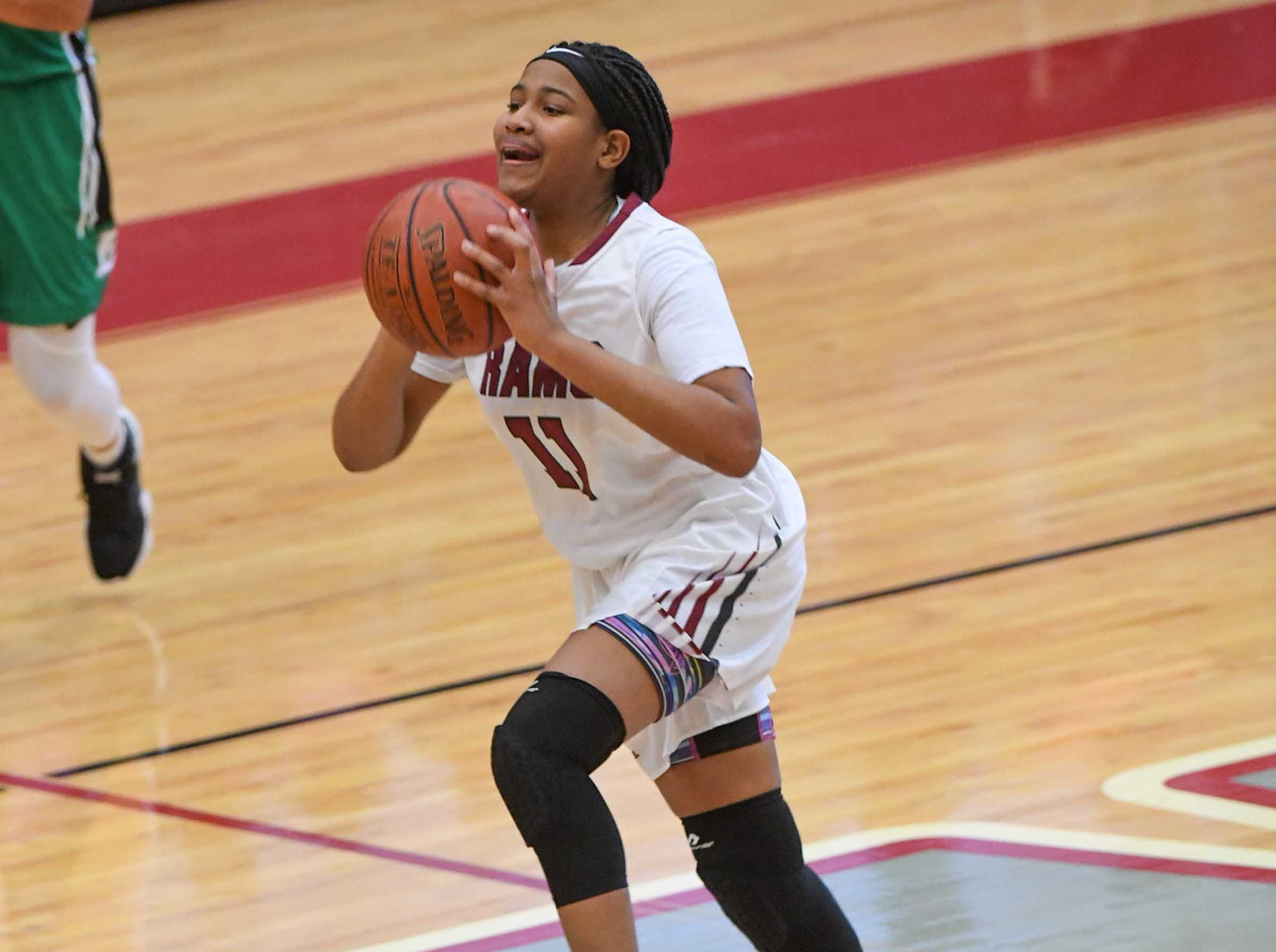 Westside freshman Destiny Middleton(11) shoots at the end of the second quarter at Westside High School in Anderson on Friday. She made the shot, but referees didn't count it with time running out before the shot.