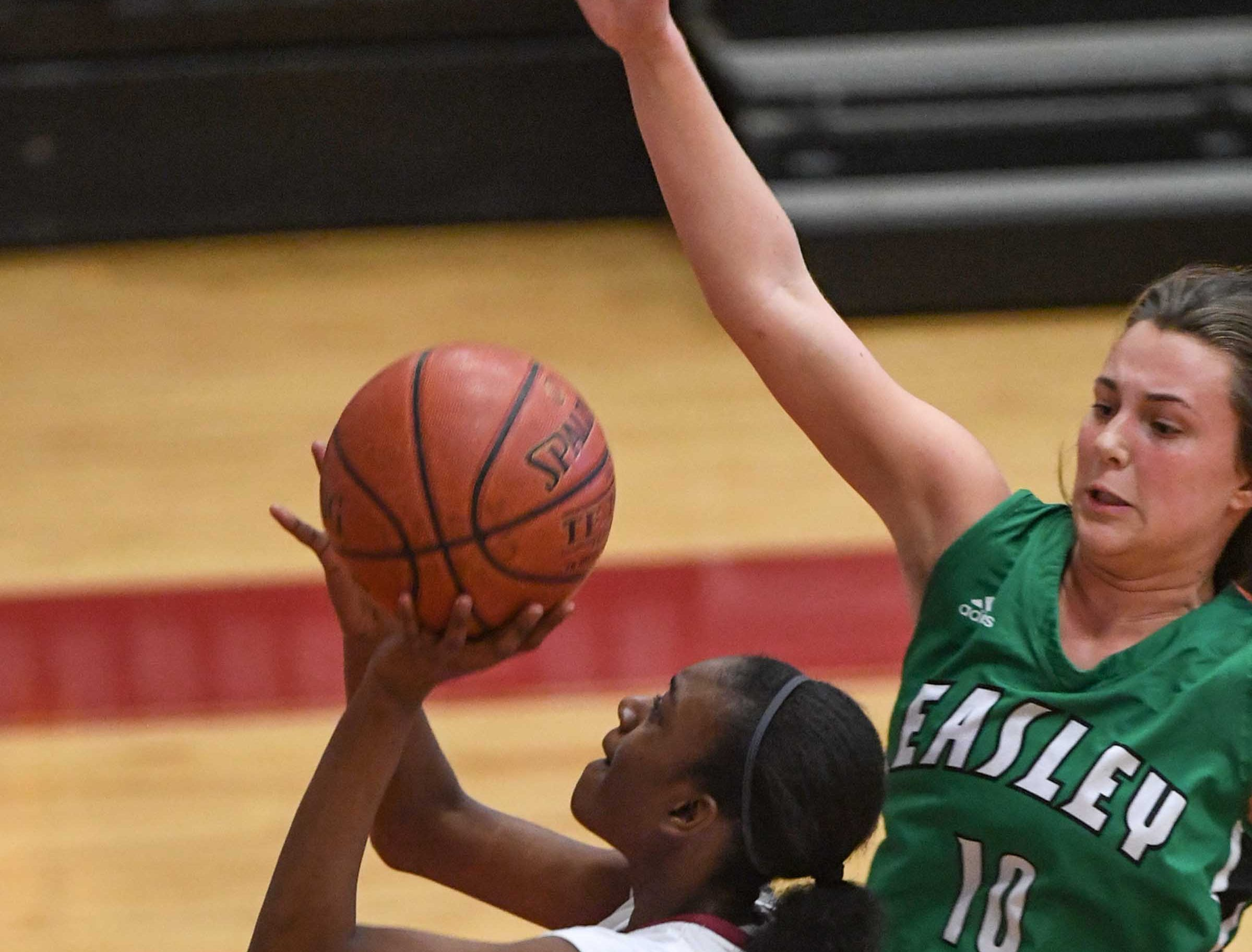 Westside freshman Aziyah Bell(4) shoots near Easley senior Aubrey Lewis(10) during the third quarter at Westside High School in Anderson on Friday.