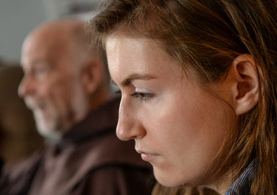 Father Bob Menard, left, campus chaplain at Saint Andrew Catholic Church in Clemson, talks near grad student Kaitlyn Conway, right, at the student center building in Clemson.