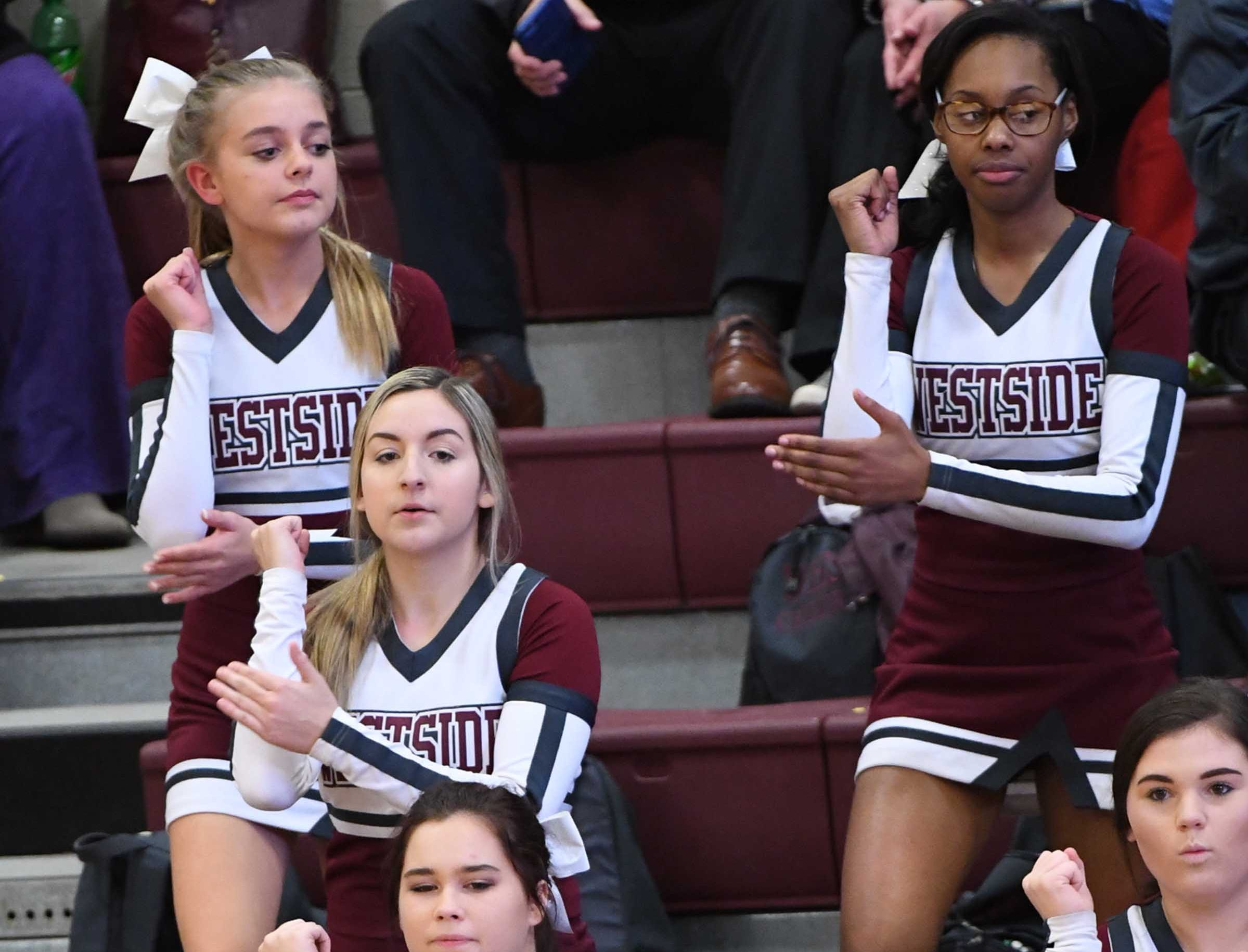 Westside High School cheerleaders during the game with Easley during the third quarter at Westside High School in Anderson on Friday.
