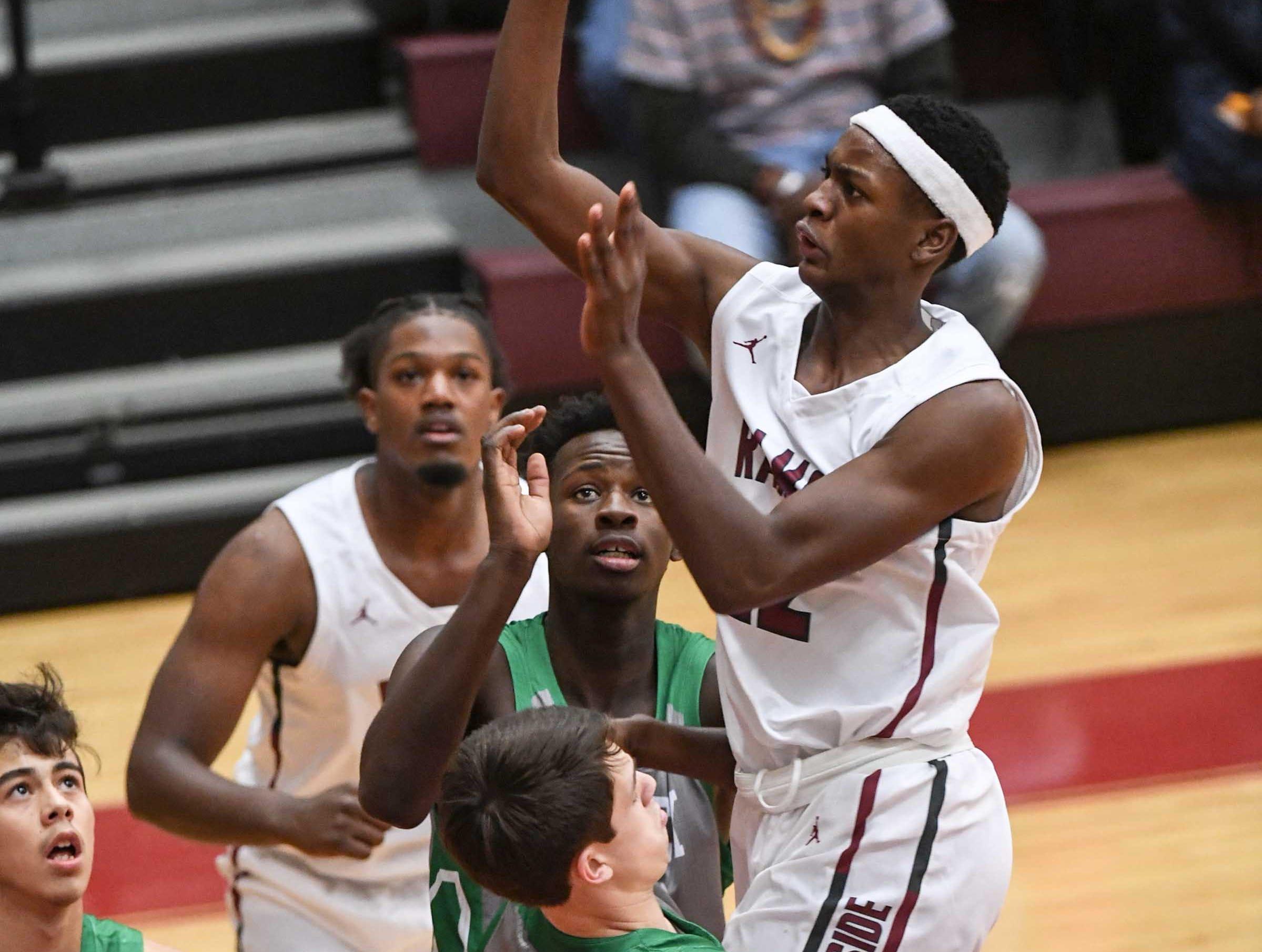 Westside sophomore Xavier Thornton(22) shoots near Easley senior Rett Lister(4) during the first quarter at Westside High School in Anderson on Friday.