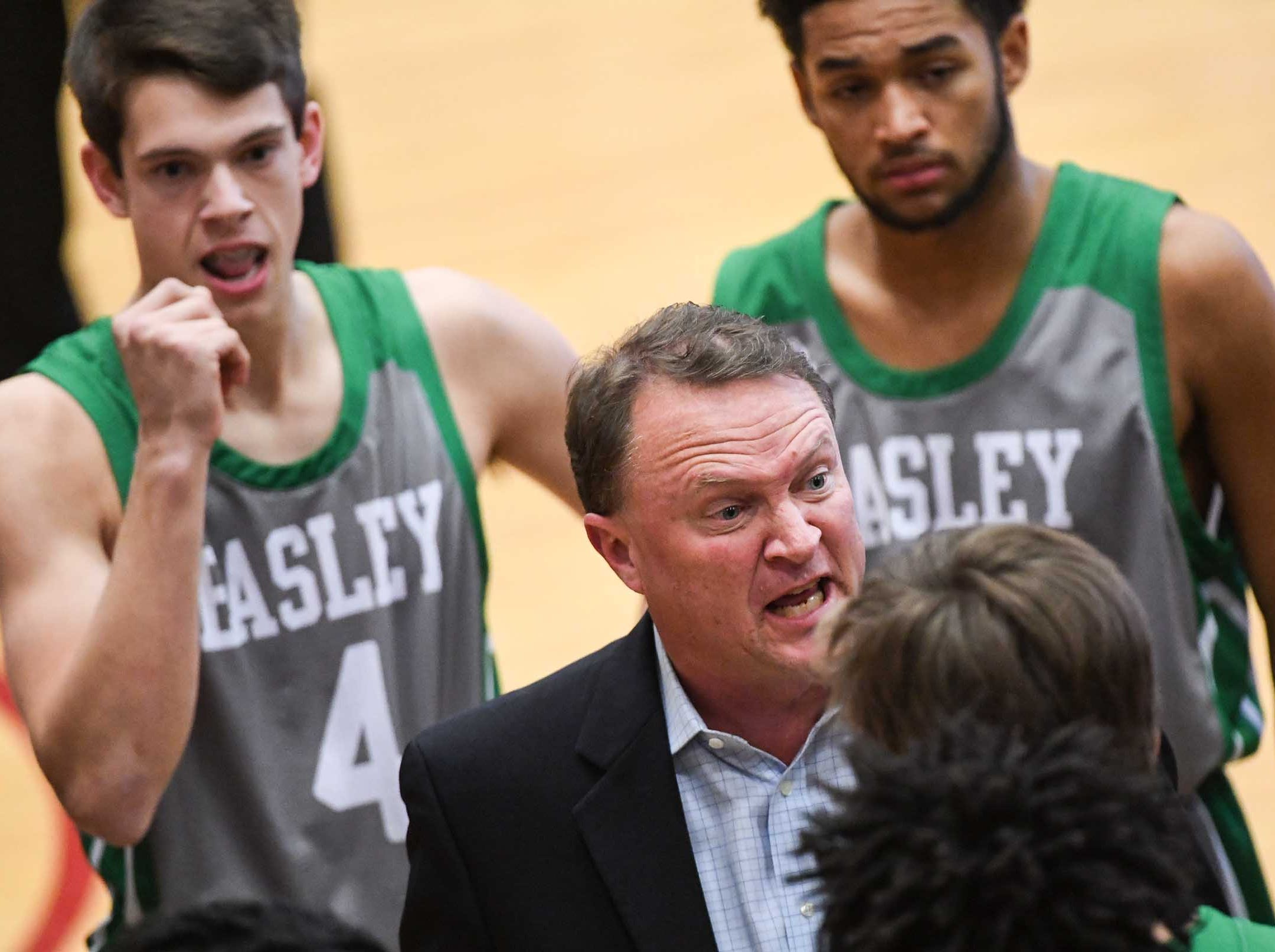 Easley head coach Mike Jones talks with players during the first quarter at Westside High School in Anderson on Friday.