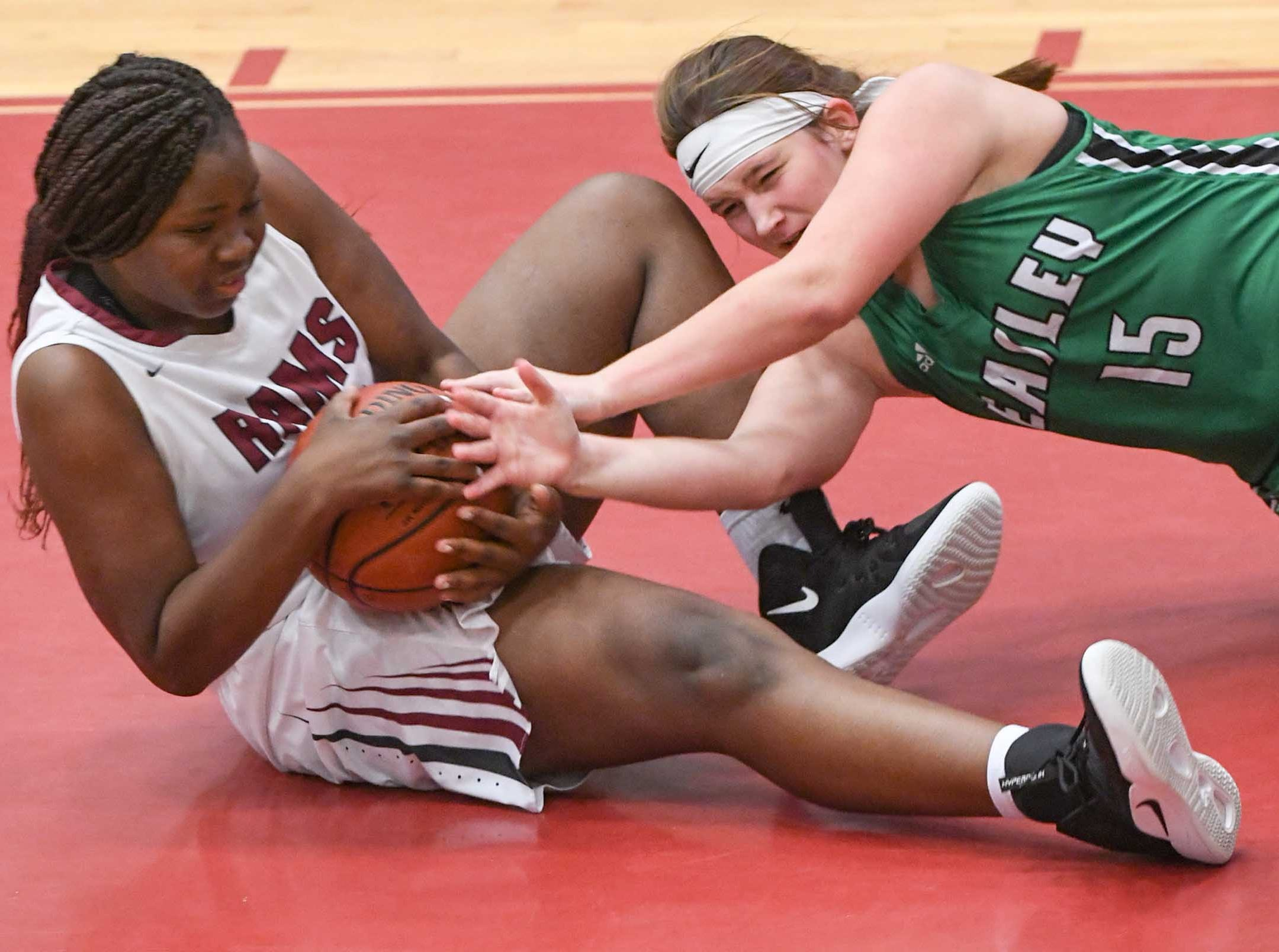 Westside sophomore Chyna Dixon(22) grabs a rebound near Easley freshman Kylie Nabors(15) during the fourth quarter at Westside High School in Anderson on Friday.