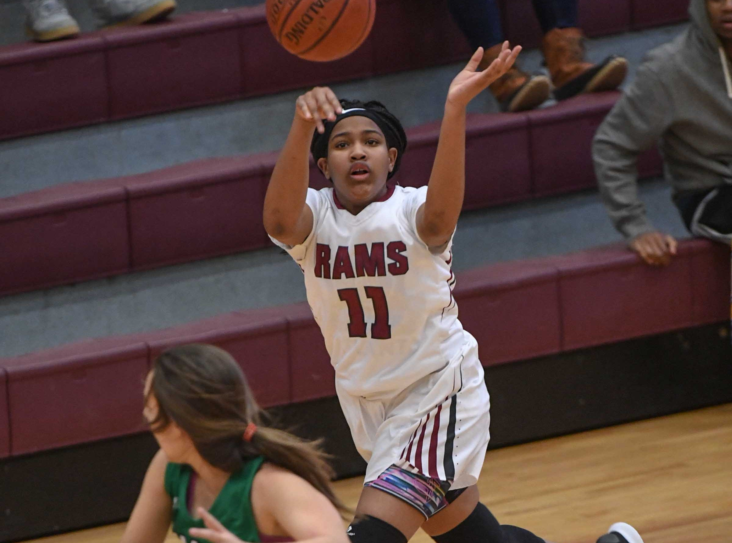 Westside freshman Destiny Middleton(11) passes near Easley sophomore Kaitlin Fuller(11) during the third quarter at Westside High School in Anderson on Friday.