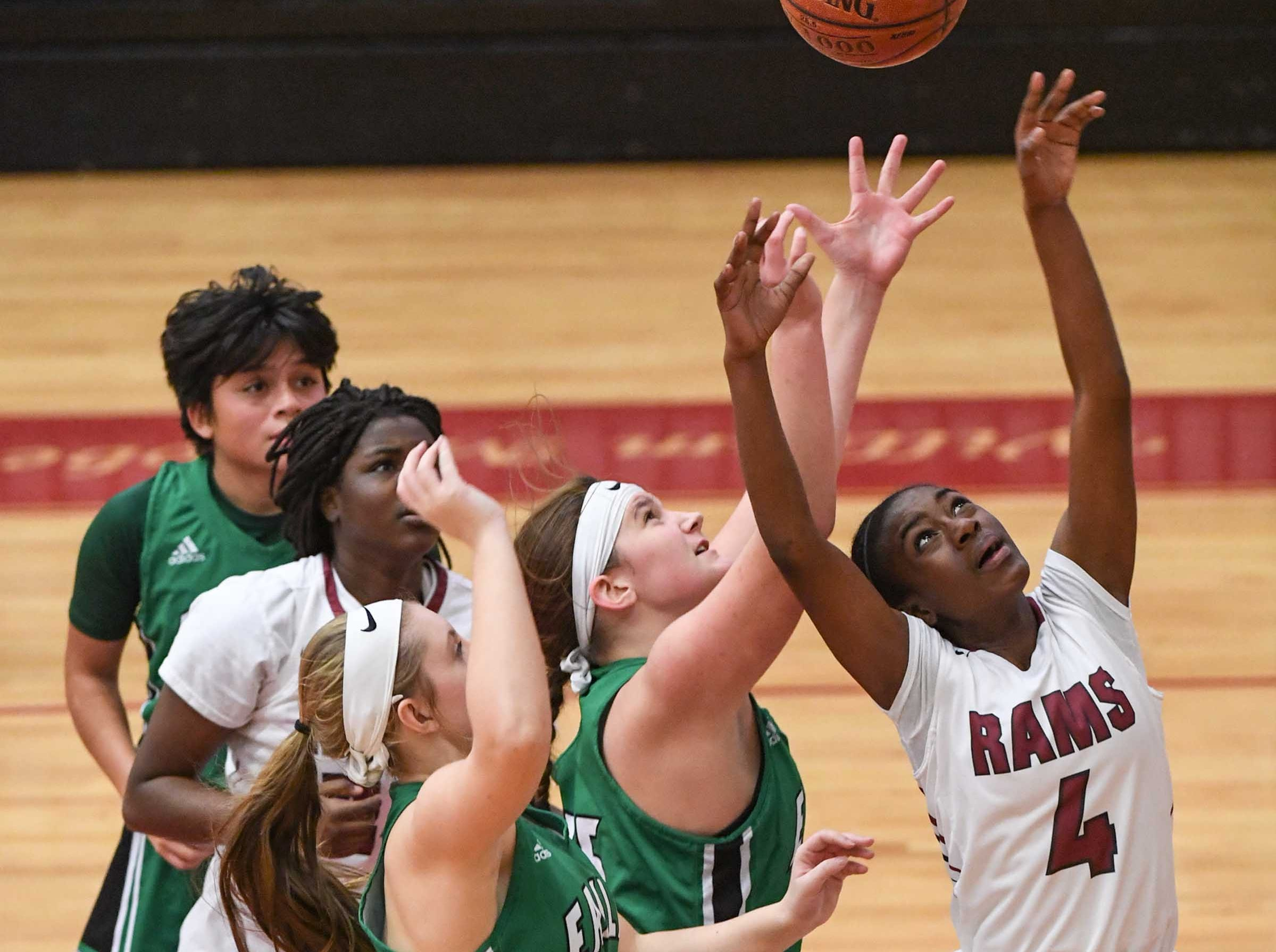 Westside freshman Aziyah Bell(4) shoots between Easley players during the third quarter at Westside High School in Anderson on Friday.
