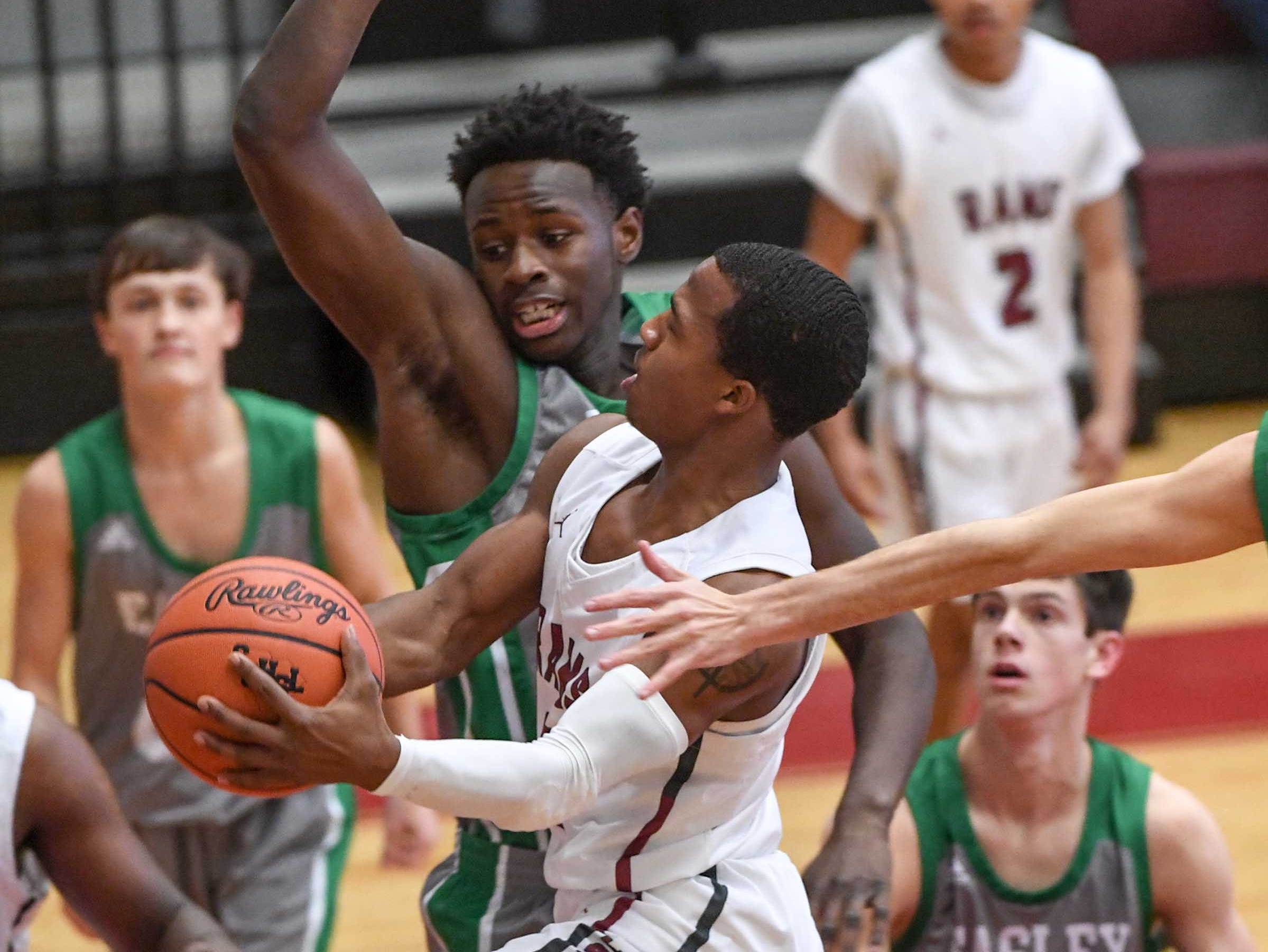 Westside senior Traye Carson(3) scores near Easley senior Griffin Smith(3) during the first quarter at Westside High School in Anderson on Friday. Carson reached 1,000 career points in the first quarter.