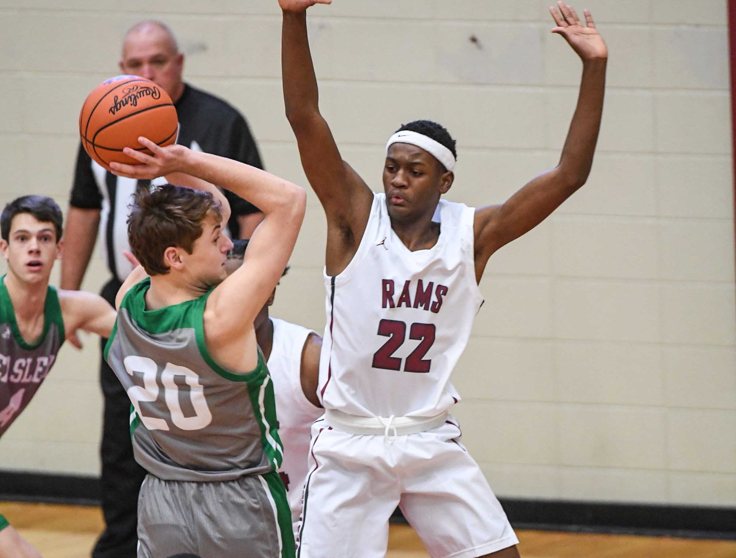 Easley senior Matt Nunnery(20) looks to pass around Westside sophomore Xavier Thornton(22) during the first quarter at Westside High School in Anderson on Friday.