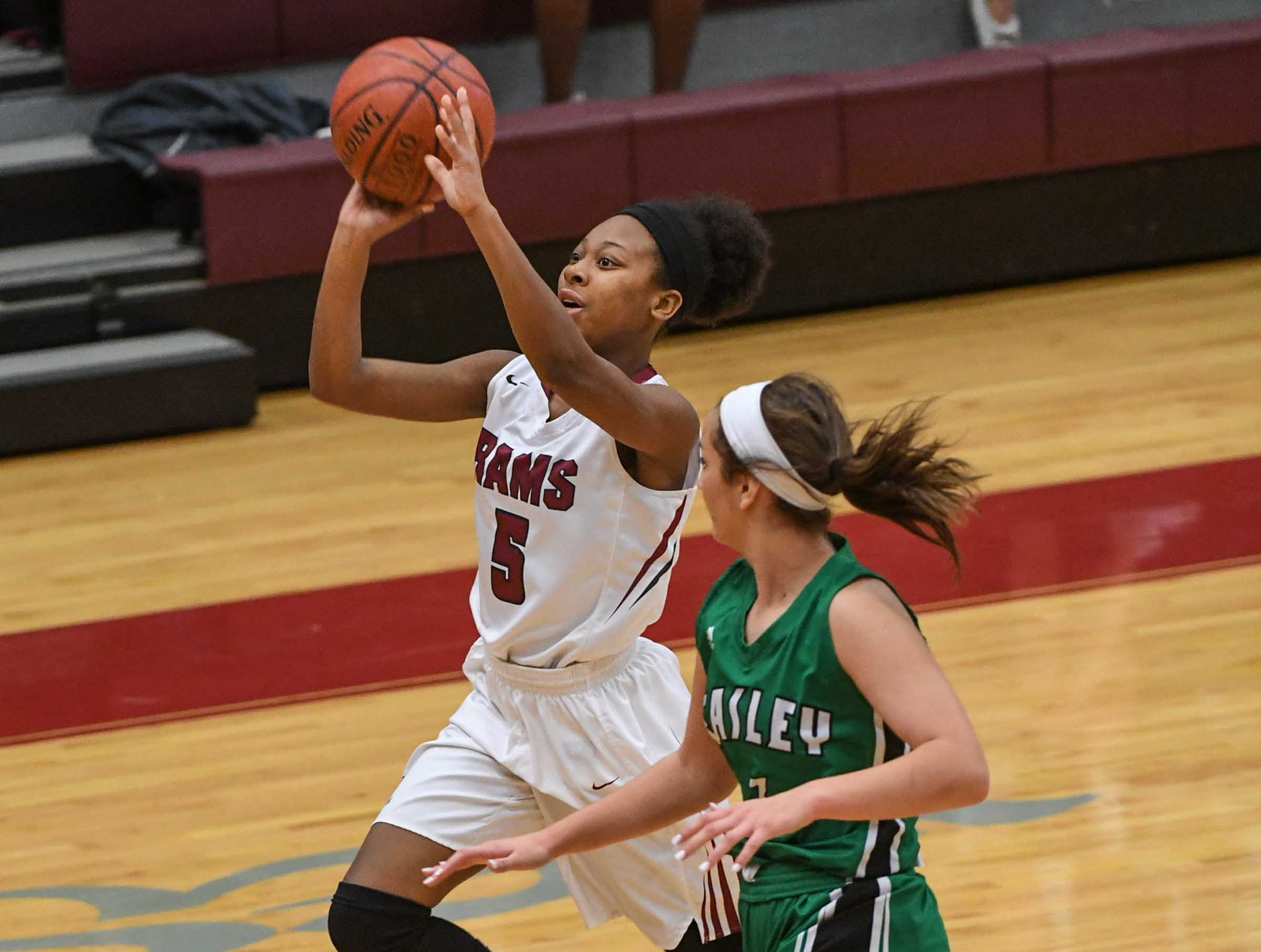 Westside senior Chelsea Adger(5) shoots during the third quarter at Westside High School in Anderson on Friday.