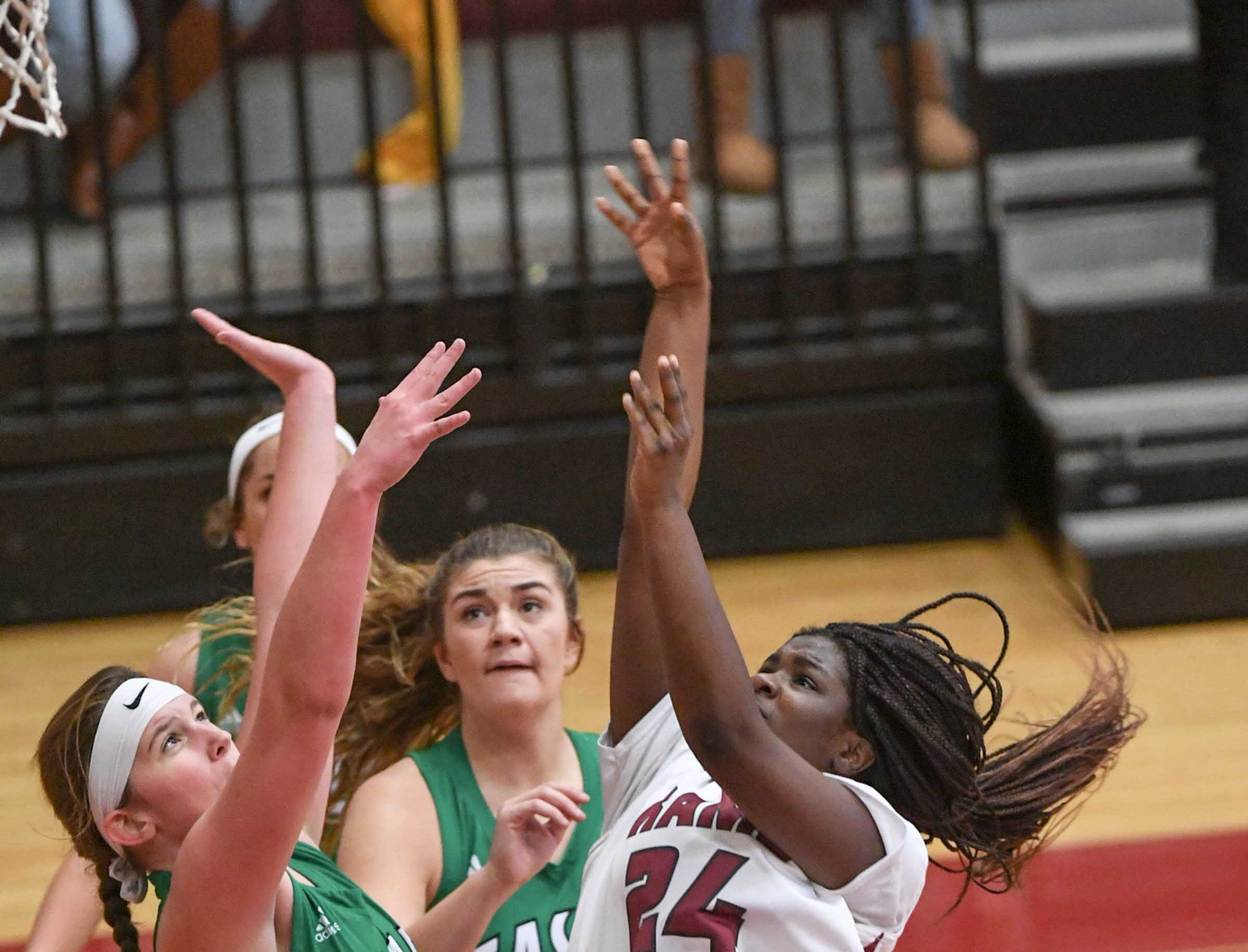 Easley freshman Kylie Nabors(15) pressures Westside sophomore Jaida Cobb(24) shooting the ball during the second quarter at Westside High School in Anderson on Friday.