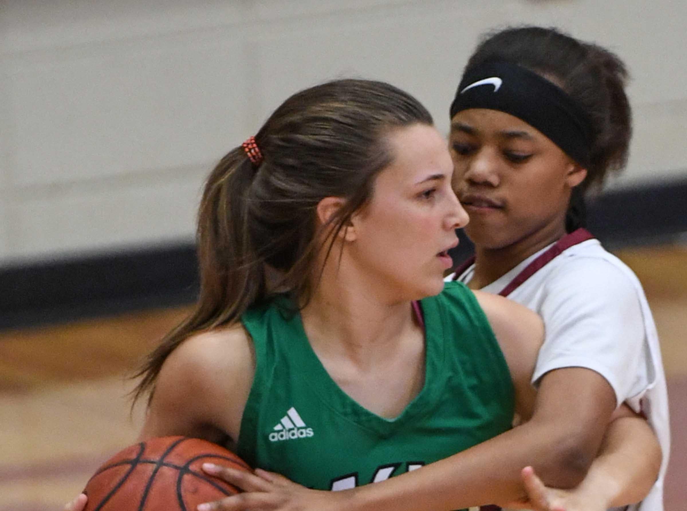 Easley senior Aubrey Lewis(10) is pressured by Westside sophomore Khia Pickens(13) during the second quarter at Westside High School in Anderson on Friday.