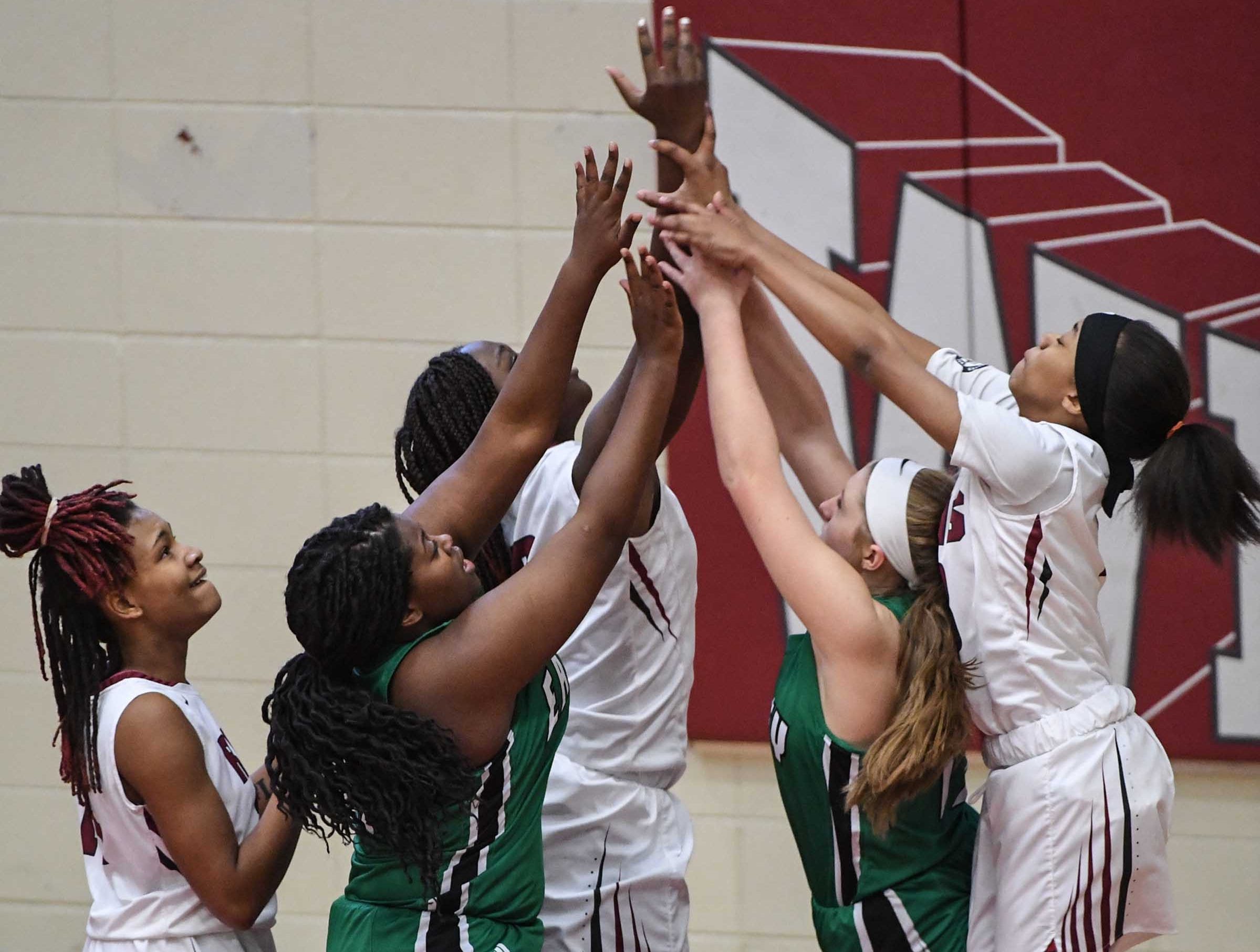 Westside High School and Easley High School reach for a ball during the third quarter at Westside High School in Anderson on Friday.