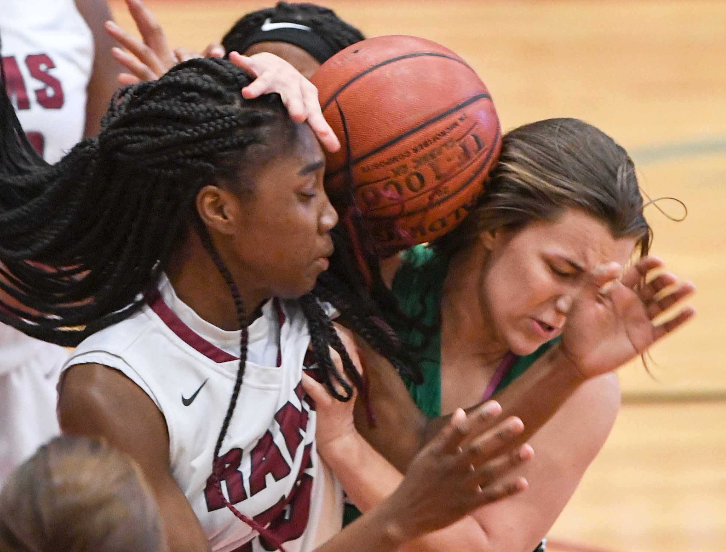 Westside senior Tanazza Wardlaw(15) and Easley senior Aubrey Lewis(10) reach for a loose ball during the fourth quarter at Westside High School in Anderson on Friday.