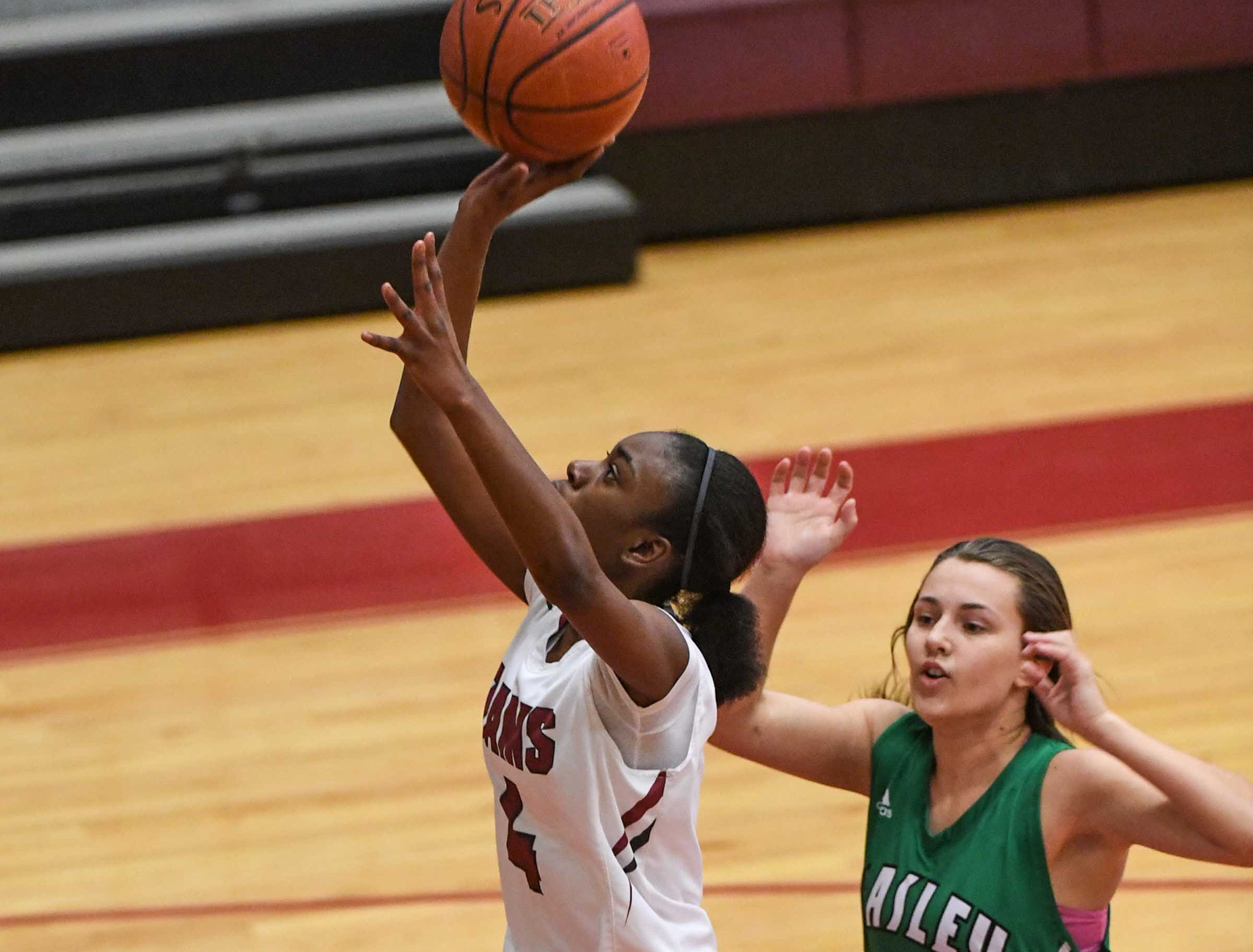 Westside freshman Aziyah Bell(4) shoots near Easley senior Aubrey Lewis(10) during the fourth quarter at Westside High School in Anderson on Friday.