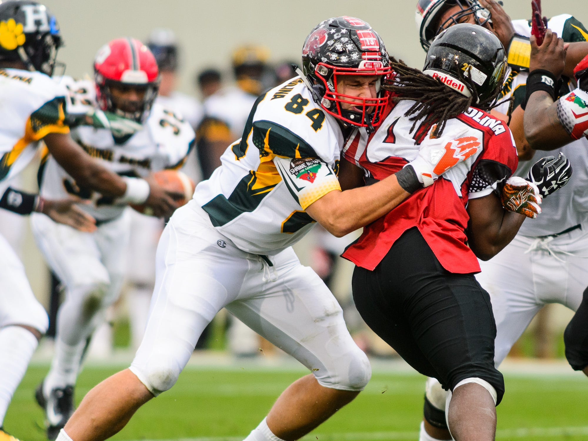 Pisgah tight end Kam Walker (84) blocks a defender during the 82nd annual Shrine Bowl of the Carolinas on Saturday, December 15, 2018 at Wofford's Gibbs Stadium in Spartanburg, SC.