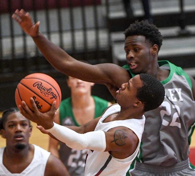 Westside senior Traye Carson(3) scores near Easley junior Jaquan Sanders(22) during the first quarter at Westside High School in Anderson on Friday. Carson reached 1,000 career points in the first quarter.