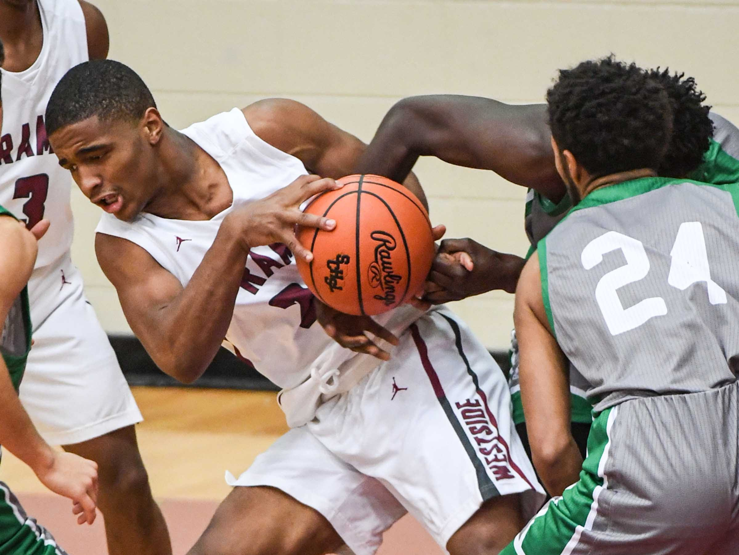 Westside senior Paul Johnson(23) rebounds near Easley junior Cameron Moore(24) during the first quarter at Westside High School in Anderson on Friday.