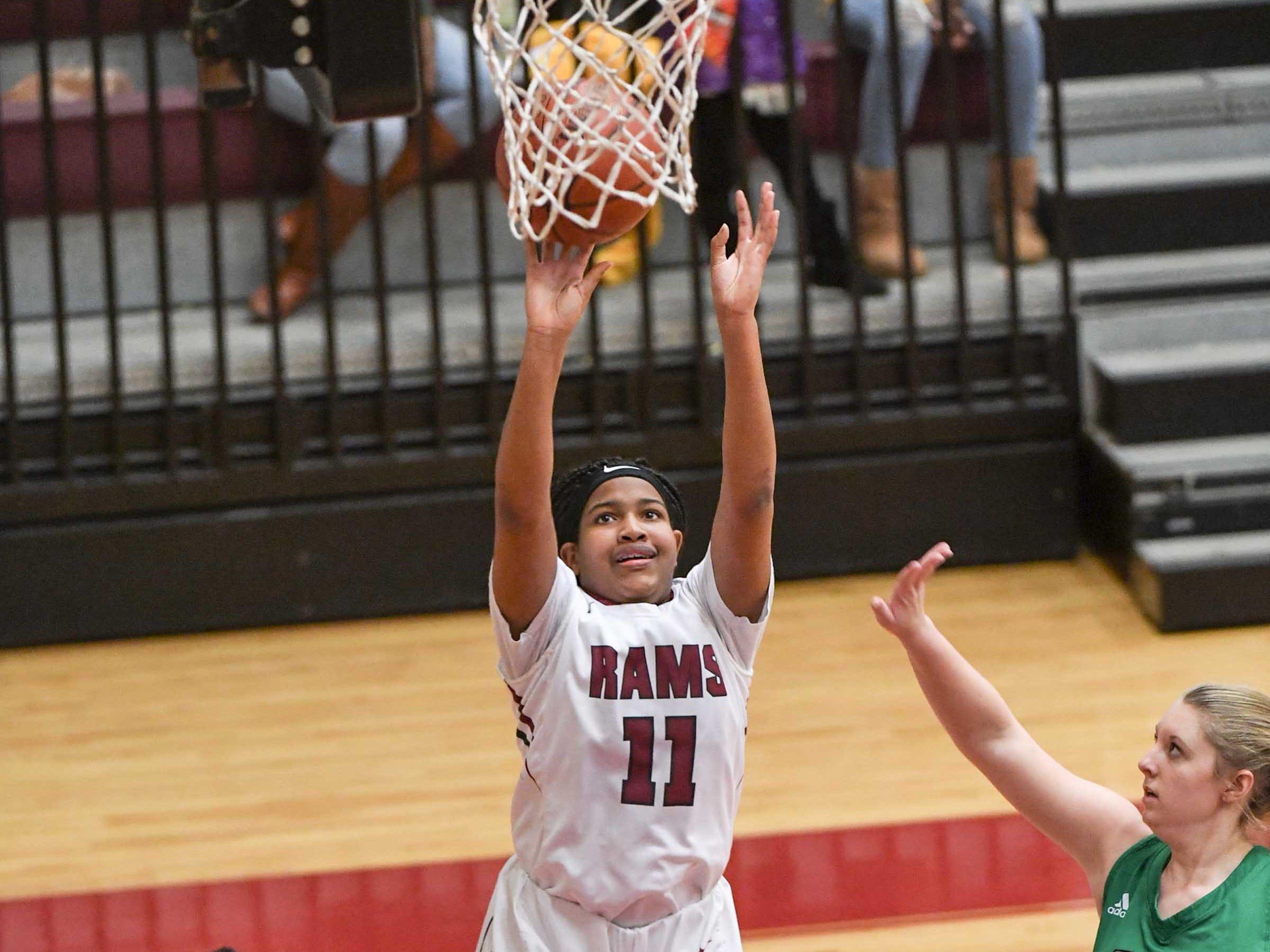 Westside freshman Destiny Middleton(11) shoots near Easley sophomore Kaitlin Fuller(11) during the third quarter at Westside High School in Anderson on Friday.