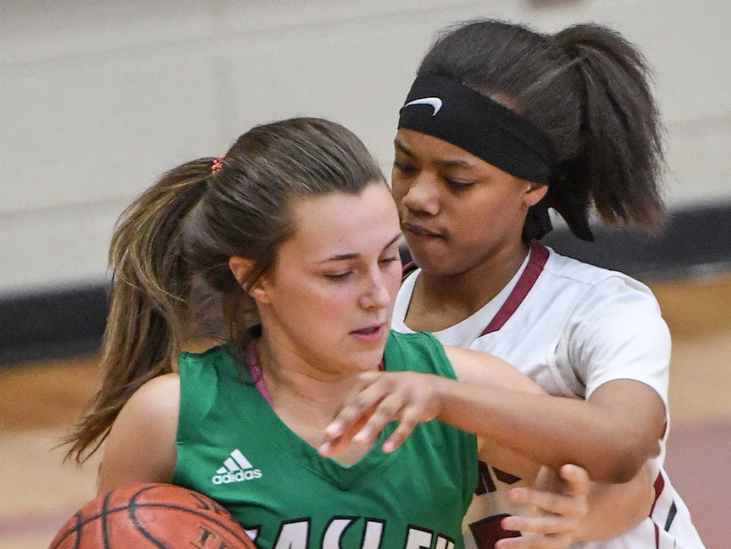 Easley senior Aubrey Lewis(10) is pressured by Westside sophomore Khia Pickens(13) during the second quarter at Westside High School in Anderson on Friday.