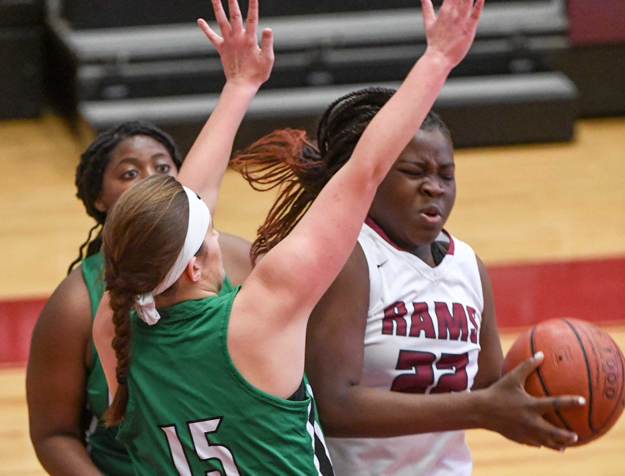 Easley freshman Kylie Nabors(15) pressures Westside sophomore Chyna Dixon(22) during the fourth quarter at Westside High School in Anderson on Friday.