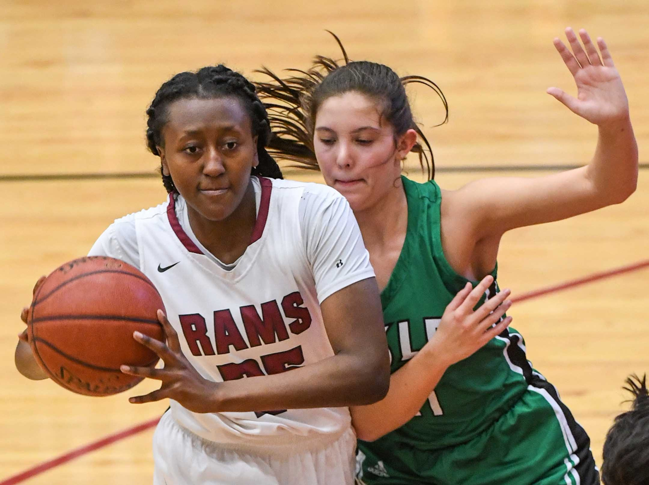 Westside junior Keyshuna Fair(25) passes near Easley sophomore Kaitlin Fuller(11) during the second quarter at Westside High School in Anderson on Friday.
